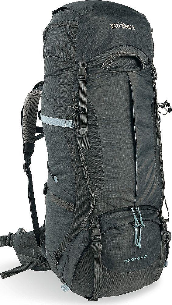 Рюкзак туристический женский Tatonka Yukon, цвет: темно-серый, 60+10 л1351.021Классический туристический рюкзак Tatonka Yukon - идеальный выбор для разнообразных походов. Рюкзак оптимизирован для грузов среднего веса (до 20-25 кг), и представляет собой идеальный баланс легкости, прочности и комфорта. Система V2 совершенствовалась с годами, и всегда получала самые лучшие оценки как от профессионалов, так и от новичков. В обновленном рюкзаке отлично сочетаются и обновленная система переноски, и более тонкие, но прочные материалы, и максимальный комфорт при переноске рюкзака. Yukon оснащен 3D-входом в основное отделение, что делает более эффективным и быстрым процесс упаковки рюкзака. Дно рюкзака выполнено из прочного непромокаемого материала Cordura.Преимущества и особенности:- Система переноски V2;- Разделенные верхнее и нижнее отделения;- Анатомические лямки, адаптированные для девушек;- Фиксаторы для треккинговых палок или ледорубов;- Полностью адаптивная система настройки спины;- Компрессионные стропы по бокам;- Прочные ручки в передней и задней частях рюкзака;- Прочные молнии размера 10;- 3D-вход в основное отделение;- Регулируемая по высоте крышка рюкзака;- Карман в крышке;- В комплекте - чехол от дождя;- Выход для питьевой системы;- Боковые эластичные карманы;- Дополнительные петли в центральной части рюкзака;- Отделение для аптечки (пустое);-Передний карман на молнии.Размер: 74 x 32 x 24 см.