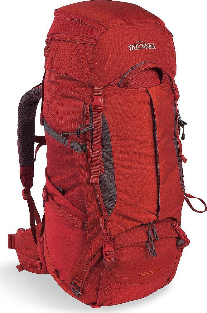 Рюкзак туристический Tatonka Yukon, цвет: красный, 50+10 л1352.254Классический туристический рюкзак Tatonka Yukon - идеальный выбор для разнообразных походов. Рюкзак оптимизирован для грузов среднего веса (до 20-25 кг), и представляет собой идеальный баланс легкости, прочности и комфорта. Система V2 совершенствовалась с годами, и всегда получала самые лучшие оценки как от профессионалов, так и от новичков. В обновленном рюкзаке отлично сочетаются и обновленная система переноски, и более тонкие, но прочные материалы, и максимальный комфорт при переноске рюкзака. Yukon оснащен 3D-входом в основное отделение, что делает более эффективным и быстрым процесс упаковки рюкзака. Дно рюкзака выполнено из прочного непромокаемого материала Cordura.Преимущества и особенности:- Система переноски V2;- Разделенные верхнее и нижнее отделения;- Анатомические лямки, адаптированные для девушек;- Фиксаторы для треккинговых палок или ледорубов;- Полностью адаптивная система настройки спины;- Компрессионные стропы по бокам;- Прочные ручки в передней и задней частях рюкзака;- Прочные молнии размера 10;- 3D-вход в основное отделение;- Регулируемая по высоте крышка рюкзака;- Карман в крышке;- В комплекте - чехол от дождя;- Выход для питьевой системы;- Боковые эластичные карманы;- Дополнительные петли в центральной части рюкзака;- Отделение для аптечки (пустое);- Передний карман на молнии.Размер: 68 x 30 x 22 см.