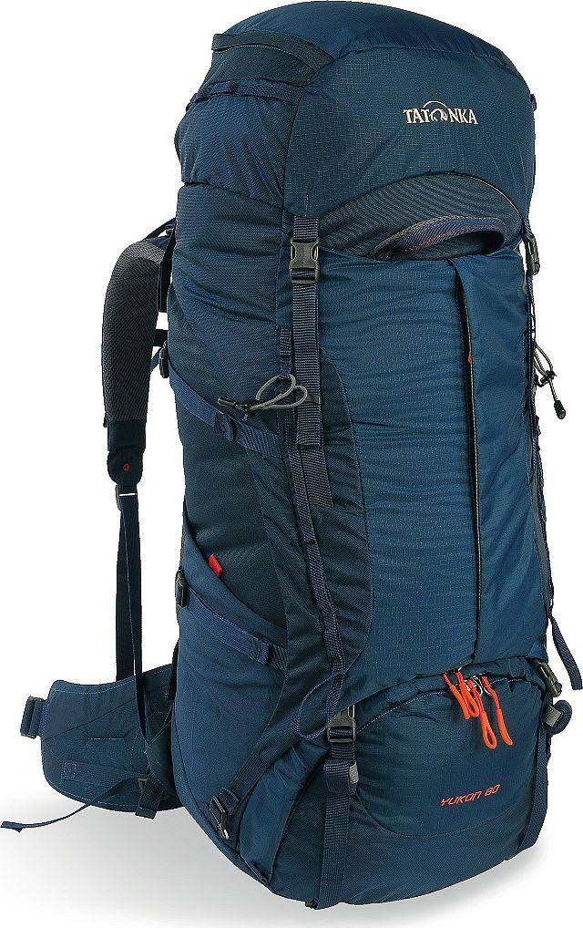 Рюкзак туристический Tatonka Yukon, цвет: темно-синий, 60+10 л1353.004Классический туристический рюкзак Tatonka Yukon - идеальный выбор для разнообразных походов. Рюкзак оптимизирован для грузов среднего веса (до 20-25 кг), и представляет собой идеальный баланс легкости, прочности и комфорта. Система V2 совершенствовалась с годами, и всегда получала самые лучшие оценки как от профессионалов, так и от новичков. В обновленном рюкзаке отлично сочетаются и обновленная система переноски, и более тонкие, но прочные материалы, и максимальный комфорт при переноске рюкзака. Yukon оснащен 3D-входом в основное отделение, что делает более эффективным и быстрым процесс упаковки рюкзака. Дно рюкзака выполнено из прочного непромокаемого материала Cordura.Преимущества и особенности:- Система переноски V2;- Разделенные верхнее и нижнее отделения;- Анатомические лямки, адаптированные для девушек;- Фиксаторы для треккинговых палок или ледорубов;- Полностью адаптивная система настройки спины;- Компрессионные стропы по бокам;- Прочные ручки в передней и задней частях рюкзака;- Прочные молнии размера 10;- 3D-вход в основное отделение;- Регулируемая по высоте крышка рюкзака;- Карман в крышке;- В комплекте - чехол от дождя;- Выход для питьевой системы;- Боковые эластичные карманы;- Дополнительные петли в центральной части рюкзака;- Отделение для аптечки (пустое);-Передний карман на молнии.Размер: 74 x 32 x 24 см.