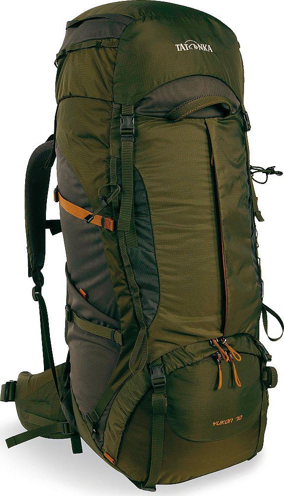 Рюкзак туристический Tatonka Yukon, цвет: оливковый, 70+10 л1354.331Классический туристический рюкзак Tatonka Yukon - идеальный выбор для разнообразных походов. Рюкзак оптимизирован для грузов среднего веса (до 20-25 кг), и представляет собой идеальный баланс легкости, прочности и комфорта. Система V2 совершенствовалась с годами, и всегда получала самые лучшие оценки как от профессионалов, так и от новичков. В обновленном рюкзаке отлично сочетаются и обновленная система переноски, и более тонкие, но прочные материалы, и максимальный комфорт при переноске рюкзака. Yukon оснащен 3D-входом в основное отделение, что делает более эффективным и быстрым процесс упаковки рюкзака. Дно рюкзака выполнено из прочного непромокаемого материала Cordura.Преимущества и особенности:- Система переноски V2;- Разделенные верхнее и нижнее отделения;- Фиксаторы для треккинговых палок или ледорубов;- Полностью адаптивная система настройки спины;- Компрессионные стропы по бокам;- Прочные ручки в передней и задней частях рюкзака;- Прочные молнии размера 10;- 3D-вход в основное отделение;- Регулируемая по высоте крышка рюкзака;- Карман в крышке;- В комплекте - чехол от дождя;- Выход для питьевой системы;- Боковые эластичные карманы;- Дополнительные петли в центральной части рюкзака;- Отделение для аптечки (пустое);- Передний карман на молнии.Размер: 78 x 34 x 25 см.Что взять с собой в поход?. Статья OZON Гид