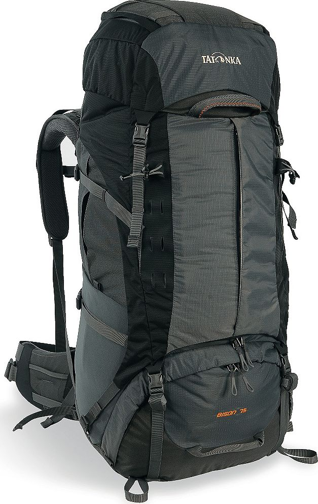 Рюкзак туристический Tatonka Bison 75, цвет: серый, 75+10 л1356.021Туристический рюкзак Tatonka Bison 75 - лучший выбор для тех, кто отправляется в длительный пеший поход c грузом, вес которого 25-35 килограмм. Благодаря системе подвески Х1, до 85% веса переносимого груза рюкзак перераспределит с плеч на бедра, тем самым спасая вашу спину и плечи от боли и усталости.Рюкзак выполнен из прочных материалов Cordura 500D, T-SquareRip и T-Snow Crust. Cordura с толщиной волокна 500 ден сочетает высокую прочность на разрыв и истирание. Она делает рюкзак чрезвычайно прочным и износостойким.T-Square Rip и T-snow Crust - лёгкие и прочные материалы, обеспечивающие большую прочность и сниженный вес рюкзака.Система Х1 состоит из двух эргономично изогнутых X-образно скрещенных шин и полиэтиленовой пластины, необходимой для формирования профиля спины. Алюминиевые шины принимают основную нагрузку системы, перераспределяют ее на мощный набедренный ремень, состоящий из жесткой изогнутой 3D полиэтиленовой пластины и многослойной подушки, создающей комфортное прилегание ремня к бедрам. Посадка набедренного пояса удобно регулируется при помощи гибкой системы затяжки ремня. Материал ремня и анатомической спинной подушки максимально гладкий, чтобы не натирать бедра и спину. В нижней части ремня расположена вставка из Lumbar Pad для предотвращения соскальзывания рюкзака. За подушкой находится короткая алюминиевая шина анатомической формы, обеспечивающая оптимальную посадку рюкзака. Спинная прокладка над поясничной подушкой имеет вогнутую форму и прошитые секции для улучшения вентиляции, которые гарантируют плотное прилегание рюкзака к телу. При правильной регулировке поясной ремень ложится на верхнюю часть бедер и принимает 80-85% всей нагрузки. Остальные 15-20% нагрузки приходятся на плечевые ремни анатомической формы с системой регулировки под рост. Конструкция спины рюкзака и плечевых ремней имеет систему каналов и вставок из AirTex, что обеспечивает великолепную вентиляцию спины. Крышка