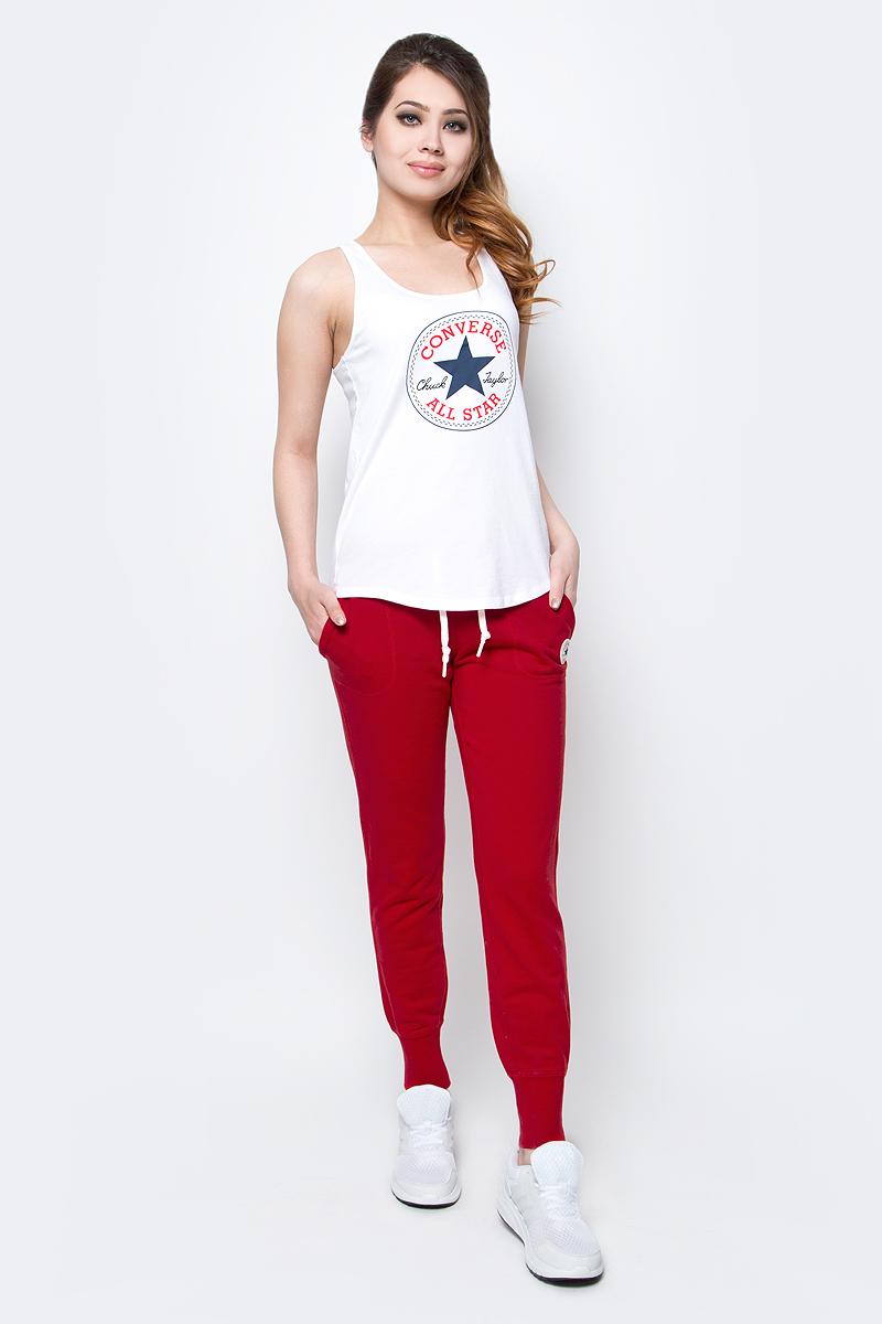 Брюки спортивные женские Converse Knitted Womens Pant, цвет: красный. 10003140934. Размер XL (50)10003140934Женские спортивные брюки Converse изготовлены из натурального хлопка. Модель на широкой эластичной резинке и шнурке на талии дополнена боковыми карманами. Низы брючин дополнены широкими резинками. Такие брюки незаменимая вещь в спортивном и летнем гардеробе. Прекрасный выбор для занятий фитнесом или активного отдыха.