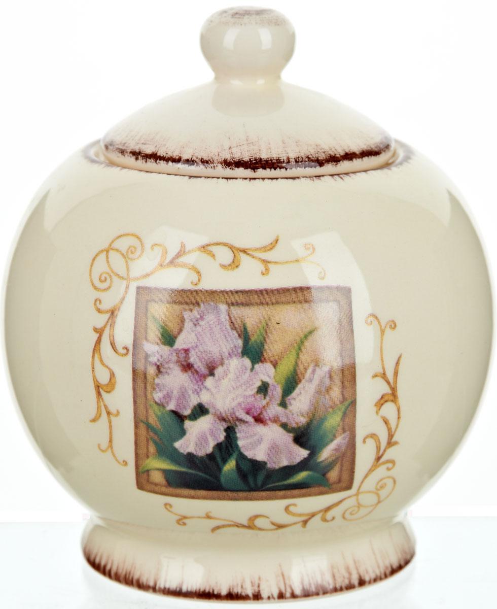 """Сахарница ENS Group """"Розовый ирис"""" с крышкой изготовлена из высококачественной керамики и декорированы изображением цветка и узорами. Емкость универсальна, подойдет как для сахара, так и для меда."""