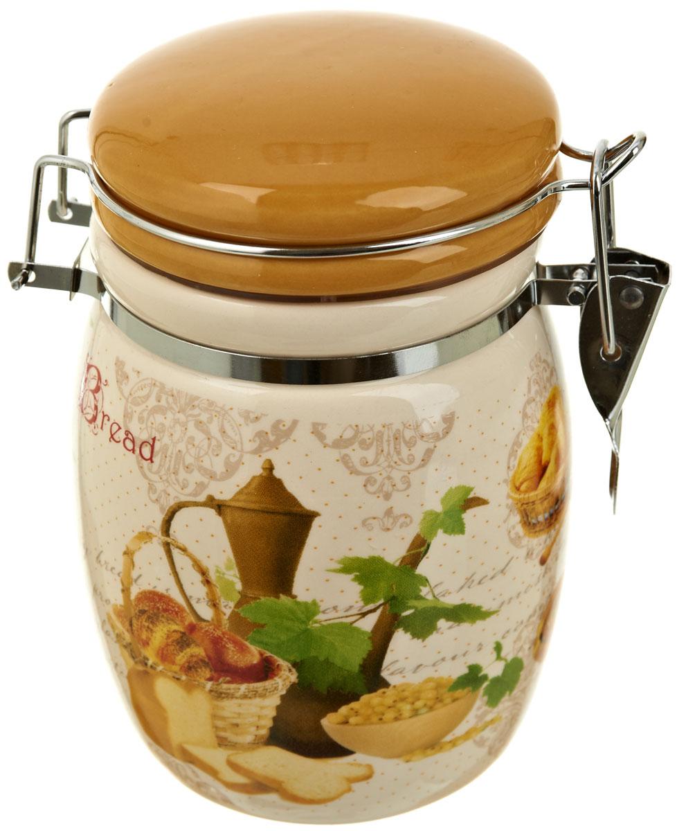 Банка для сыпучих продуктов Polystar Хлеб, 600 млL1581891Банка для сыпучих продуктов Хлеб изготовлена из прочной керамики, закрывается крышкой. Банка прекрасно подойдет для хранения различных сыпучих продуктов: чая, кофе, сахара, круп и многого другого. Благодаря силиконовой прослойке и бугельному замку, крышка герметично закрывается, что позволяет дольше сохранять продукты свежими.Изящная емкость не только поможет хранить разнообразные сыпучие продукты, но и стильно дополнит интерьер кухни. Объем: 600 мл.