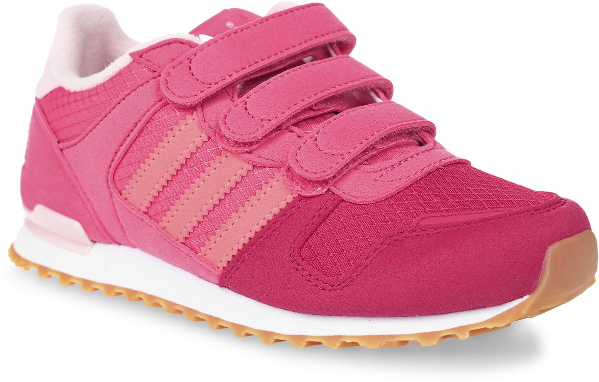 Кроссовки детские adidas Zx 700 Cf, цвет: розовый. S76246. Размер 30S76246Детские кроссовки adidas Originals Zx Flux C выполнены из сетчатого текстиля и дополнены вставками из искусственной кожи. Язычок украшен ярлыком в логотипом бренда. Обувь фиксируется на ноге при помощи классической шнуровки. Подкладка выполнена из текстиля. Термопластичная литая дышащая стелька OrthoLite® из ЭВА обеспечивает длительную амортизацию при небольшом весе, препятствует распространению бактерий, вызывающих запах, благодаря специальному составу с диметилоктадецил [3-(триметоксисилил)пропил] аммония хлоридом. Подошва из резины дополнена оригинальным рифлением, пяточный каркас выполнен из термополиуретана, как на аутентичных моделях ZX 80-х годов.