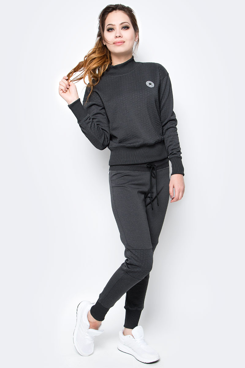 Брюки спортивные женские Converse Pant, цвет: серый. 10003546001. Размер XL (50)10003546001Женские спортивные брюки Converse изготовлены из качественного эластичного материала. Модель на широкой эластичной резинке и шнурке дополнена текстильными вставками на коленях. Низы брючин дополнены широкими резинками. Такие брюки незаменимая вещь в спортивном и летнем гардеробе. Прекрасный выбор для занятий фитнесом или активного отдыха.