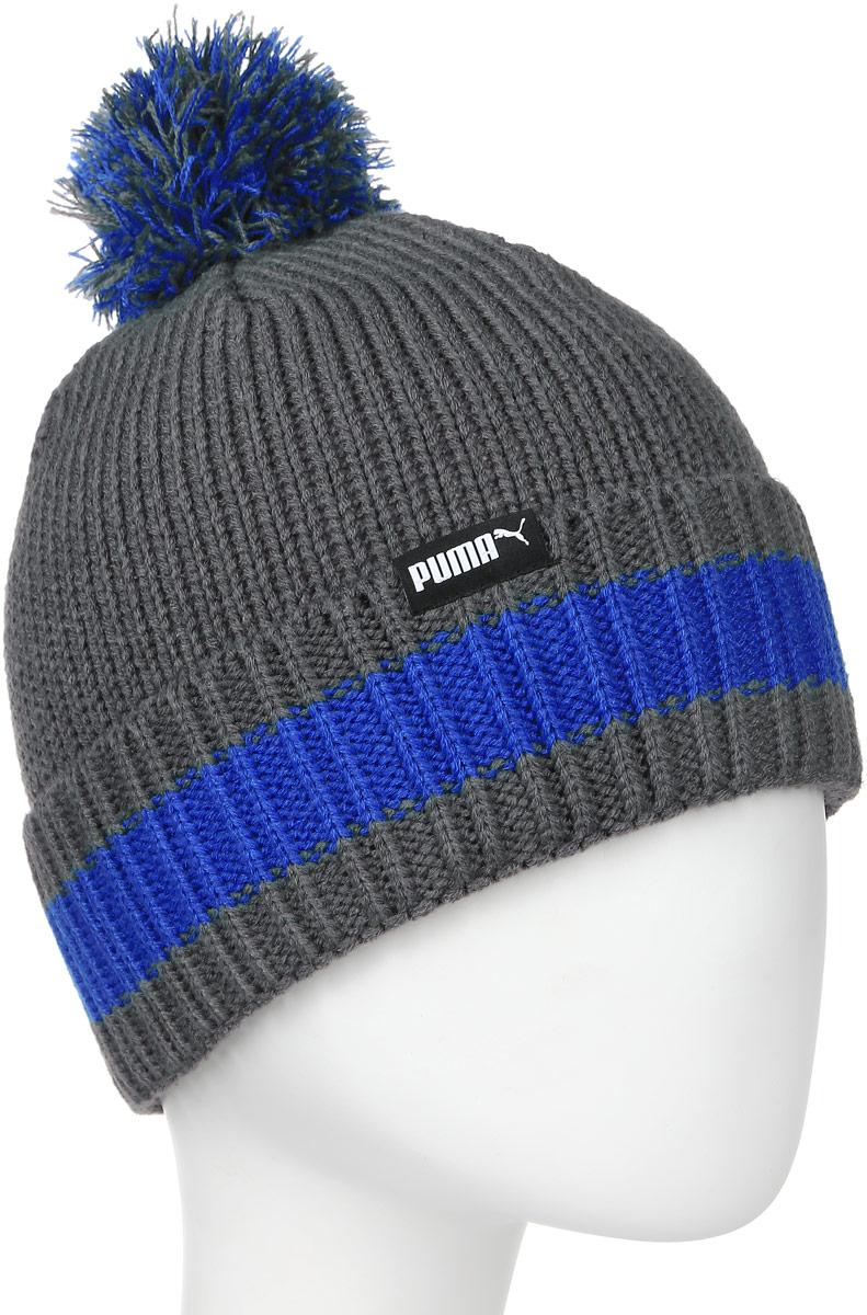 Шапка Puma LS Phoenix Knit hat, цвет: серый. 02105203. Размер универсальный021052_03Шапка с помпоном плотной вязки с отворотом в резинку украшена полосой по краю, вышитым логотипом спереди и тканым ярлыком с логотипом PUMA сзади.