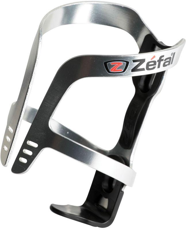 Флягодержатель Zefal Pulse Aluminium, цвет: серый металлик1710AФлягодержатель Zefal Pulse Aluminium – это комбинация алюминия и полимерных материалов, обеспечивающая небольшой вес и высокую надёжность крепления фляги. Так же полимерный демпфер отлично гасит вибрации и надёжно фиксирует флягу на месте. Этот флягодержатель подходит для всех типов велосипедов, имеющих стандартные крепления на раме (2 болта) и всех фляг.ZEFAL – старейший французский производитель велосипедных аксессуаров премиального качества, основанный в 1880 году, является номером один на французском рынке велосипедных аксессуаров.Вес 40 г.