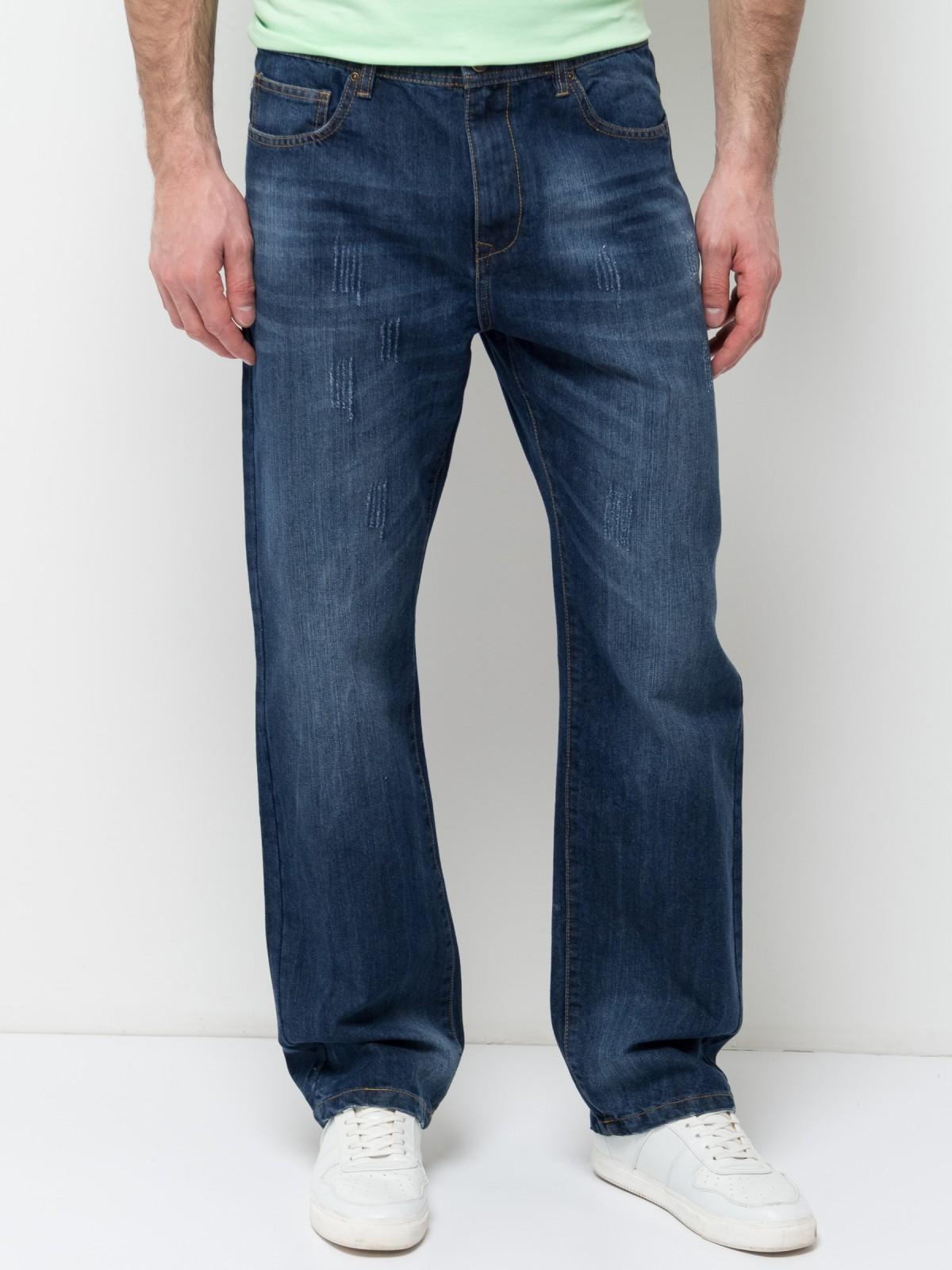 Джинсы мужские Sela Denim, цвет: синий джинс. PJ-235/1082-7253. Размер 32-34 (48-34)PJ-235/1082-7253Стильные мужские джинсы Sela, изготовленные из качественного хлопкового материала с потертостями, станут отличным дополнением гардероба. Джинсы прямого кроя и стандартной посадки на талии застегиваются на застежку-молнию и пуговицу. На поясе имеются шлевки для ремня. Модель представляет собой классическую пятикарманку: два втачных и накладной карманы спереди и два накладных кармана сзади.