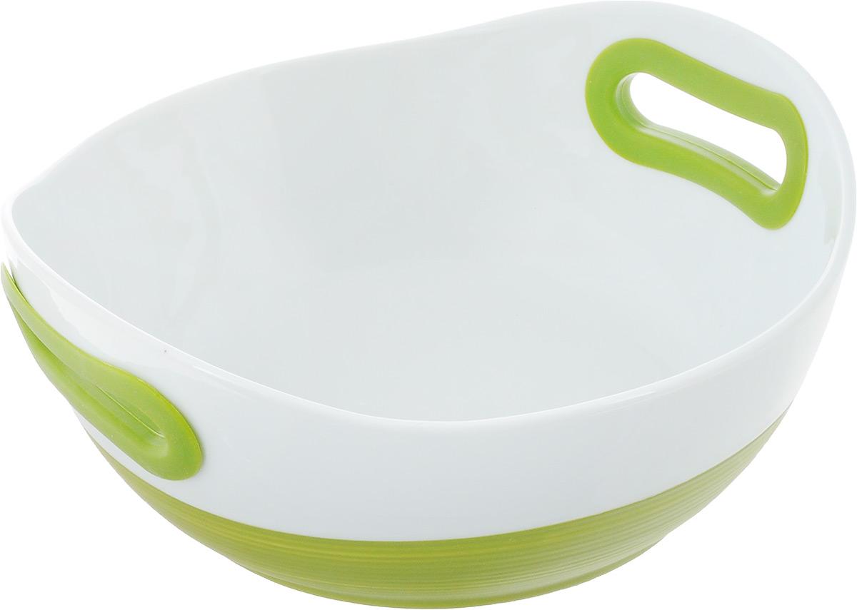 Блюдо для запекания BartonSteel, цвет: зеленый, белый, 1,1 л2412BSКруглое блюдо для запекания BartonSteel выполнено из высококачественного жаропрочного фарфора с покрытием глазурью. Изделие имеет толстые стенки, благодаря которым пища равномерно и быстро пропекается. Поверхность устойчива к запахам и красителям, легко моется. Ручки снабжены силиконовыми вставками, что убережет ваши руки от воздействия высоких температур. Такое блюдо идеально подходит для запекания разнообразных блюд, а также их последующей сервировки. Можно использовать в микроволновой печи и духовке при температуре до 220°С, можно мыть в посудомоечной машине.