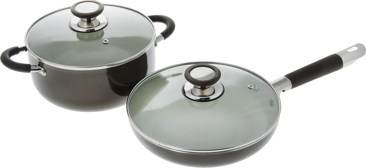 Набор посуды Bohmann, с крышками, 4 предмета6204BНNEWНабор посуды Bohmann состоит из кастрюли и сковородки со стеклянными крышками. Предметы набора выполнены из высококачественного алюминия с внутренним керамическим покрытием. Такое покрытие предотвращает прилипание пищи к стенкам. Посуда равномерно нагревается. Изделия оснащены удобными ручками с силиконовыми вставками, они не нагреваются в процессе готовки и обеспечивают надежный хват. Крышка изготовлена из жаростойкого стекла и снабжена ручкой, металлическим ободом и отверстием для выпуска пара.Такой набор не только станет незаменимым помощником в приготовлении ваших любимых блюд, но и стильно оформит интерьер кухни. Подходит для всех типов плит, кроме индукционных. Можно мыть в посудомоечной машине.Объем кастрюли: 4 л.Диаметр: 22 см.Высота стенки: 10,5 см.Объем сковороды: 2,2 л.Диаметр: 24 см.Высота стенки: 5 см.