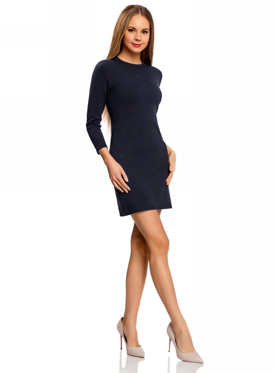 Платье oodji Ultra, цвет: темно-синий. 63912222-1B/46244/7900N. Размер XL (50)63912222-1B/46244/7900NТрикотажное платье oodji изготовлено из качественного смесового материала. Облегающая модель выполнена с круглой горловиной и рукавами 3/4.