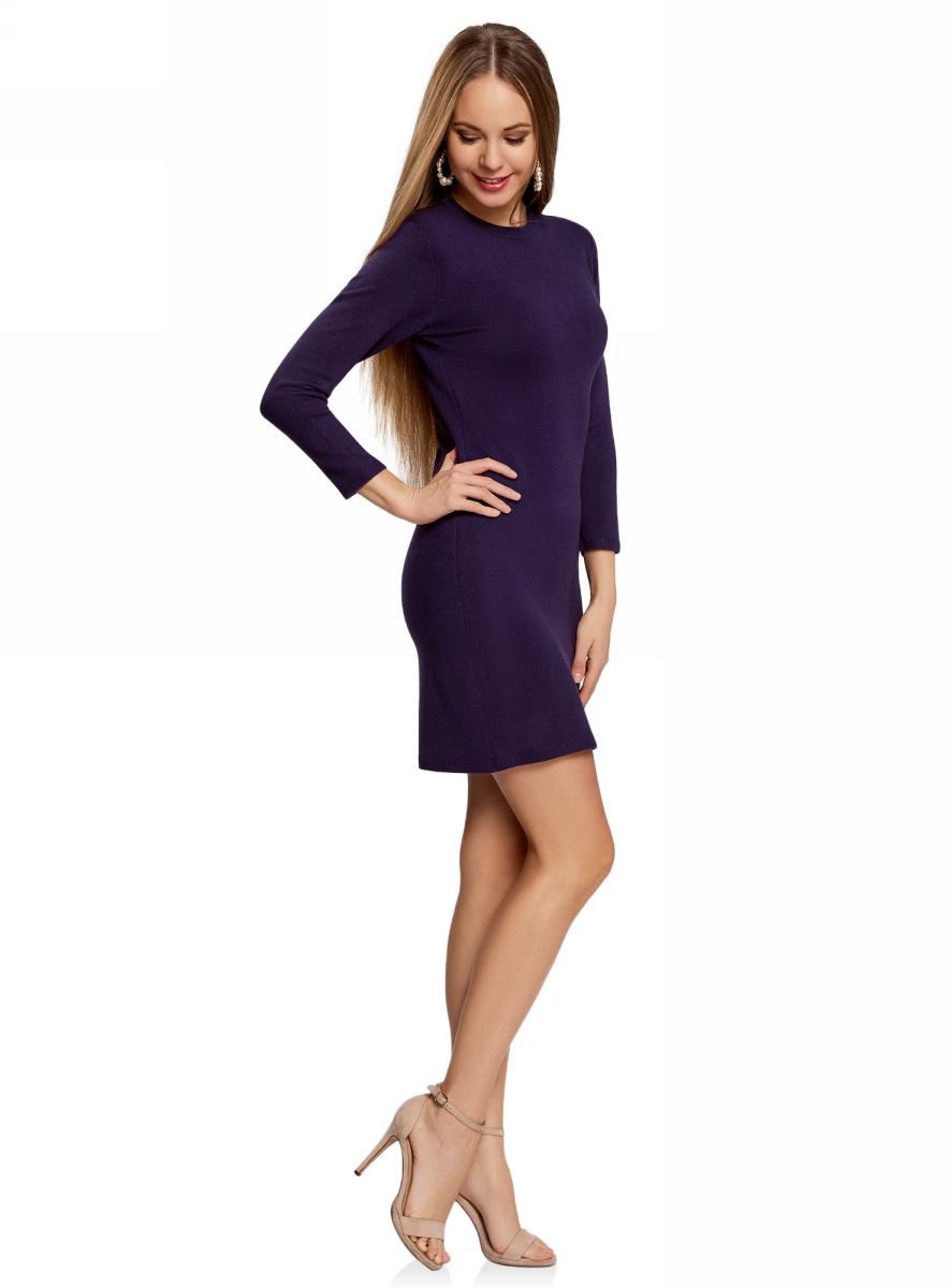 Платье oodji Ultra, цвет: темно-фиолетовый. 63912222-1B/46244/8800N. Размер XL (50)63912222-1B/46244/8800NТрикотажное платье oodji изготовлено из качественного смесового материала. Облегающая модель выполнена с круглой горловиной и рукавами 3/4.