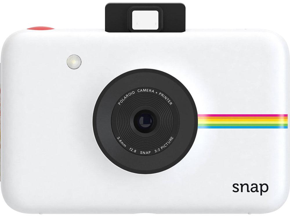 Polaroid Snap, White фотокамера мгновенной печатиPOLSP01WEPolaroid Snap - компактная камера, способная сразу распечатать полученный снимок.В устройстве используется технология ZINK, позволяющая получать отпечатки без использования чернил. Данная разработка уже успела зарекомендовать себя в других камерах Polaroid. Снимки разрешением 10 Мп мгновенно преобразуются в отпечатки размером 2х3 дюйма.Хранить фотографии можно на карте памяти microSD объёмом до 32 ГБ. Дополняют картину несколько сценариев съёмки, возможность выставить таймер, а также режим, в котором камера делает шесть снимков за 10 секунд.Формат отпечатков: 50 мм х 75 мм