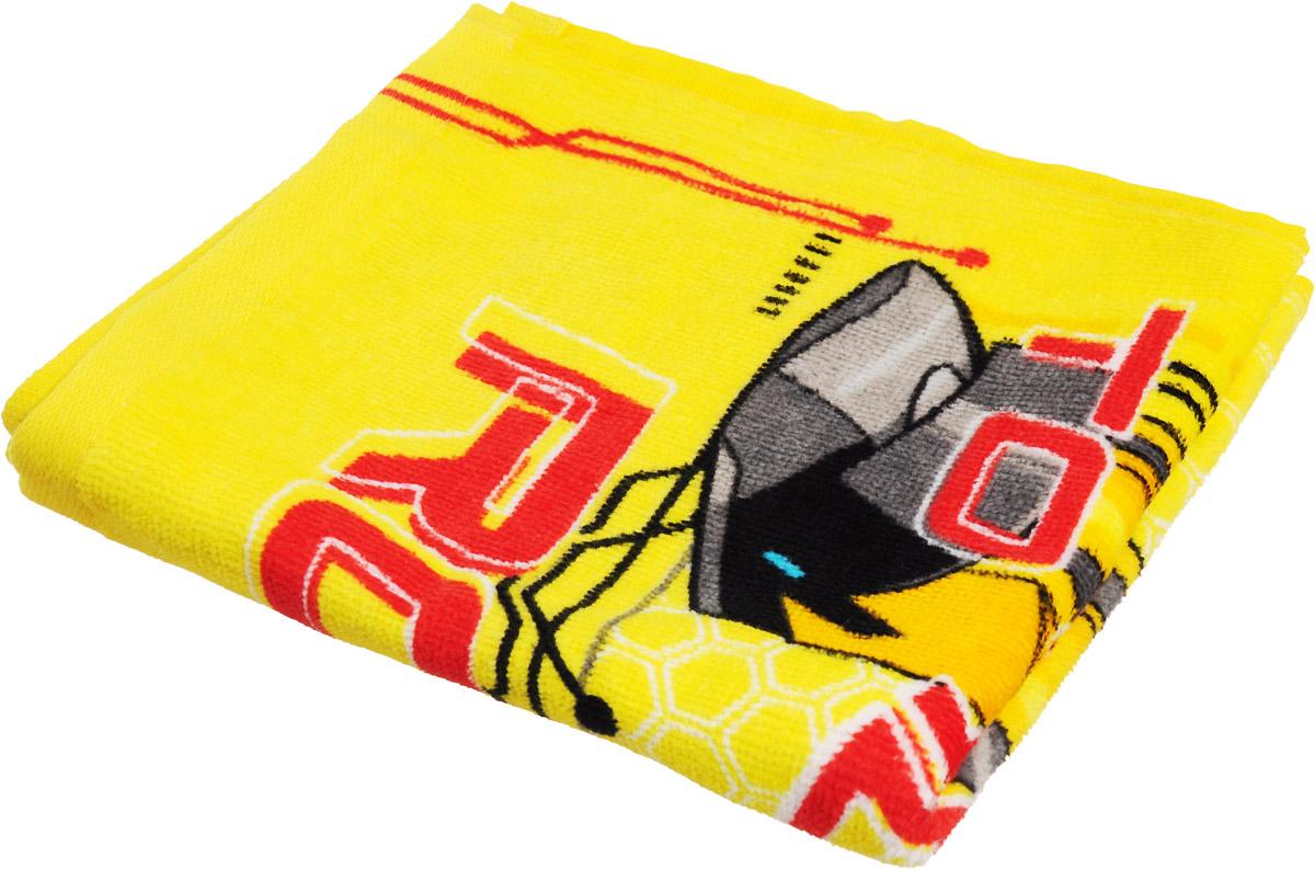 """Мягкое хлопковое полотенце Bravo """"Трансформеры"""" подарит вам и вашему малышу мягкость и необыкновенный  комфорт в использовании. Полотенце украшено изображением робота-трансформера из мультфильма """"Transformers:  Robots in Disguise"""".  Красочное изображение любимого героя и невероятная мягкость полотенца обязательно приведут в восторг вашего  ребенка и превратят любое купание в веселую и увлекательную игру.  Ткань не вызывает аллергических реакций, обладает высокой гигроскопичностью и воздухопроницаемостью.  Полотенце великолепно впитывает влагу и не теряет своих свойств после многократной стирки.  Порадуйте себя и своего ребенка таким замечательным подарком! Режим стирки: при 40°С."""