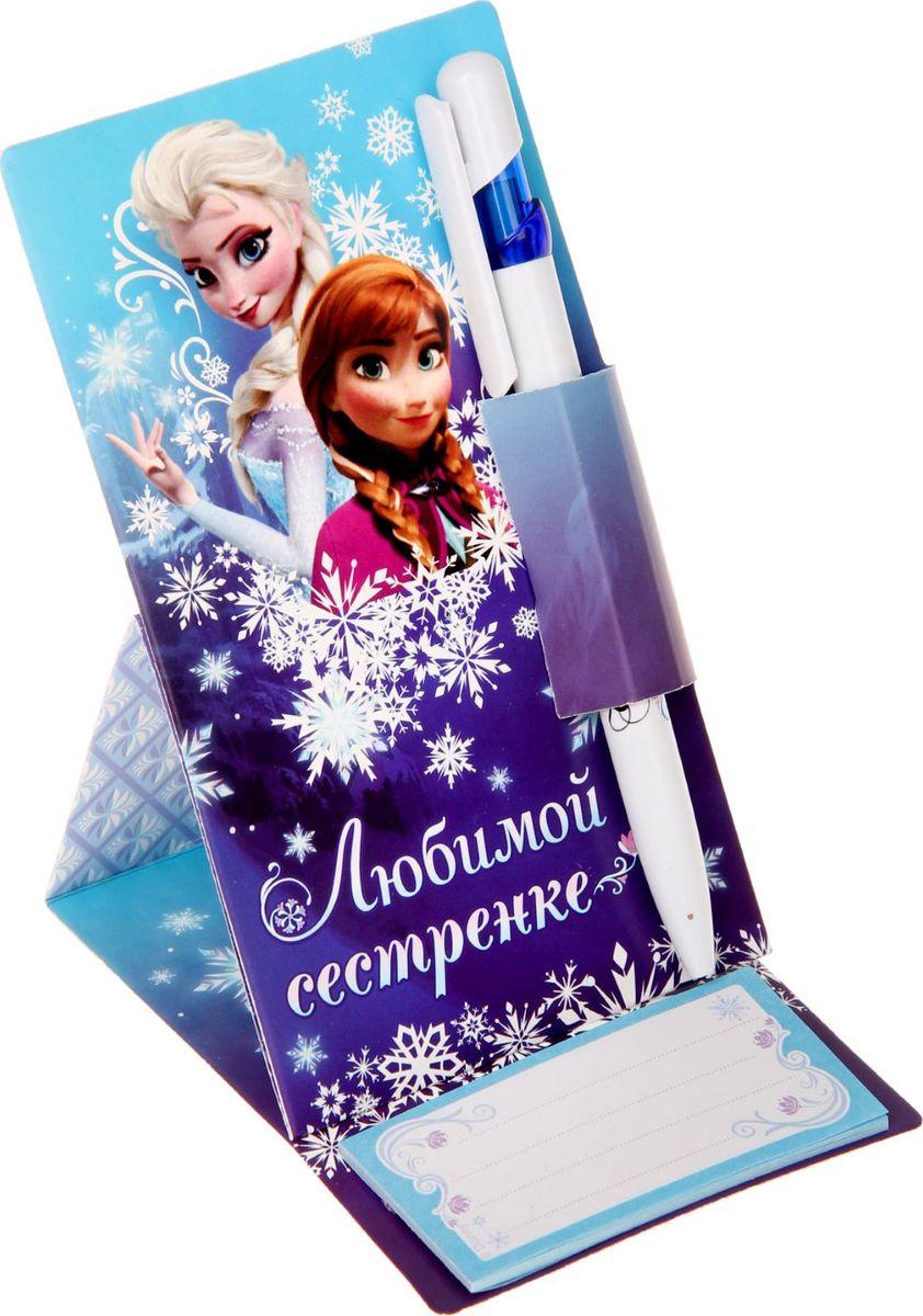 Disney Ручка шариковая Любимой сестренке Холодное сердце на открытке с блоком для записей синяя1154279Дети любят все яркое и цветное. Письменные принадлежности не исключение. Шариковая ручка Disney Любимой сестренке. Холодное сердце - станет любимой у ребенка. Пишущий инструмент не потеряется благодаря картонной подставке, а все неожиданные и гениальные мысли не забудутся с блоком для записей с отрывными листами размером 8 х 4 см. Такой подарок не только яркий и красивый, но и практичный и функциональный. Он будет служить ребенку не один день!