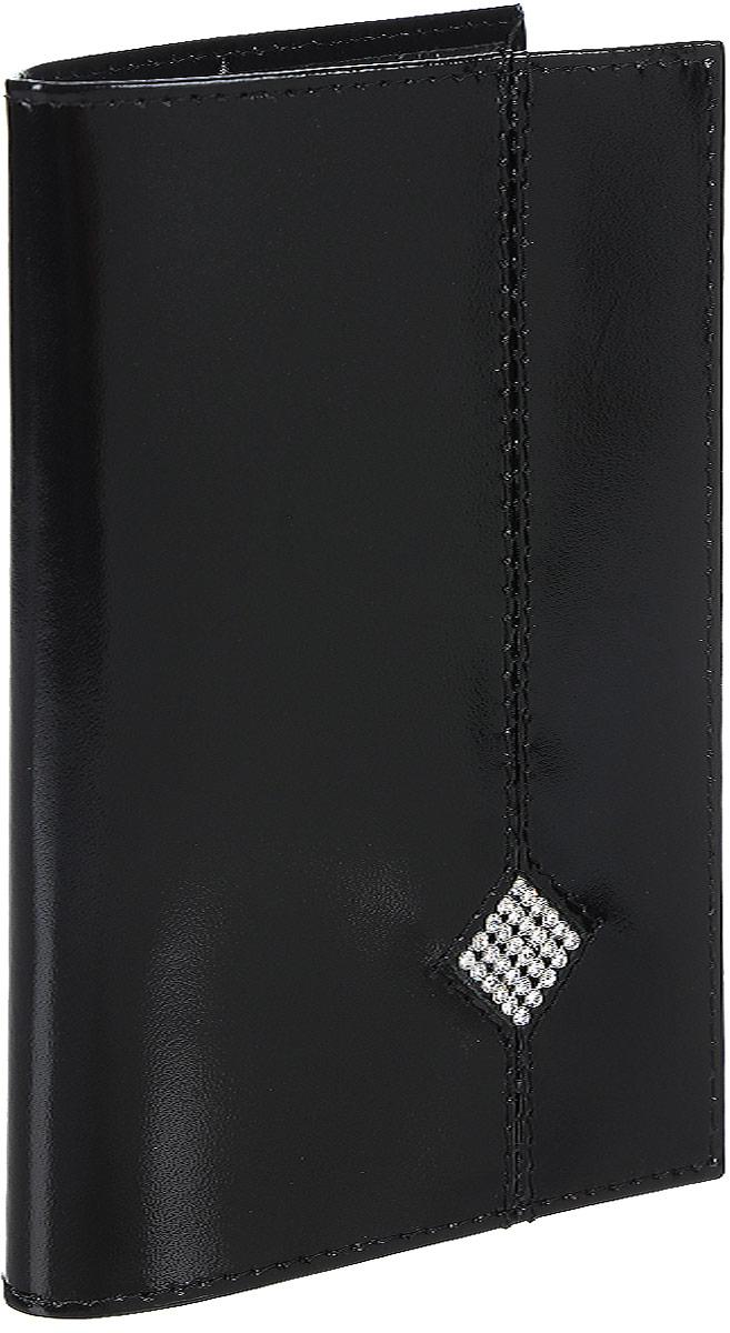 Обложка для паспорта Dimanche Daimond, цвет: черный. 170Натуральная кожаОбложка для паспорта Dimanche Daimond выполнена из натуральной высококачественной кожи. На внутреннем развороте два кармана из прозрачного пластика. Снаружи обложка оформлена аппликацией из стразов в виде ромба.Упаковано изделие в фирменную картонную коробку.Такая обложка станет отличным подарком для человека, ценящего качественные и стильные вещи.