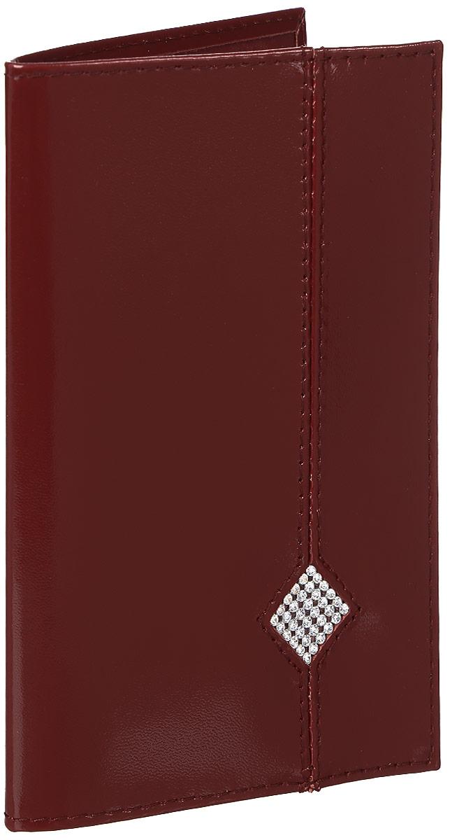 Обложка для паспорта Dimanche Гранат, цвет: бордовый. 130Натуральная кожаОбложка для паспорта Dimanche Гранат изготовлена из натуральной кожи бордового цвета и оформлена мелкими стразами, выстроенными в виде ромба. Внутри содержится два прозрачных захвата для паспорта. Внутренняя отделка - из стильной ткани насыщенного красного цвета.Обложка Dimanche Гранат не только поможет сохранить внешний вид вашего паспорта и защитит его от повреждений, но и станет ярким аксессуаром, который подчеркнет ваш неповторимый стиль. Обложка упакована в фирменную подарочную коробку.