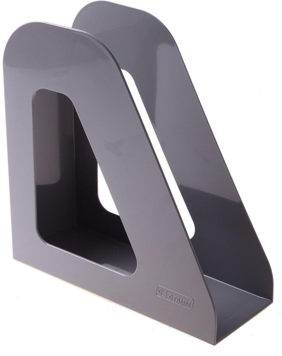 Стамм Лоток для бумаг вертикальный Фаворит цвет серый 584872584872Лоток для бумаг Стамм выполнен в современном элегантном дизайне из высококачественного пластика.Лоток имеет одно отделение для листов формата А4, на рабочем столе устанавливается вертикально.С лотком для бумаг Стамм у вас больше не возникнут сложности с поддержанием порядка на столе!