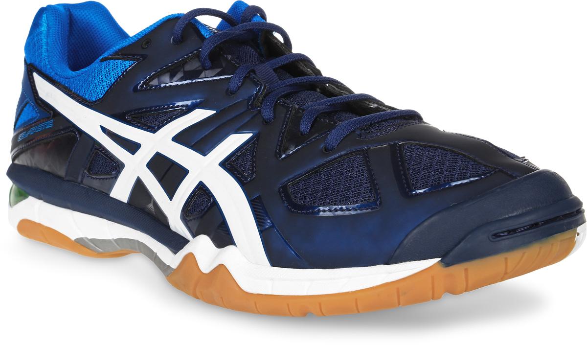 Кроссовки для волейбола мужские Asics Gel-Tactic, цвет: темно-синий, синий. B504N-5801. Размер 15 (48)B504N-5801Кроссовки обеспечивают максимальный комфорт во время многочасовых перемещений по площадке, а также придают необходимое ускорение для стремительного рывка. Износоустойчивая синтетическая кожа продлевает срок службы кроссовок. Непревзойденный комфорт модели обеспечивают технология Asics Gel (специальный вид силикона) в носке и пятке, которая снижает нагрузку на пятку, колени и позвоночник спортсмена, и волшебная подошва - вентилируемая средняя подошва, которая минимизирует вес обуви и максимизирует циркуляцию воздуха. Смелый дизайн кроссовок сделает спортсмена заметным на всем протяжении игры.