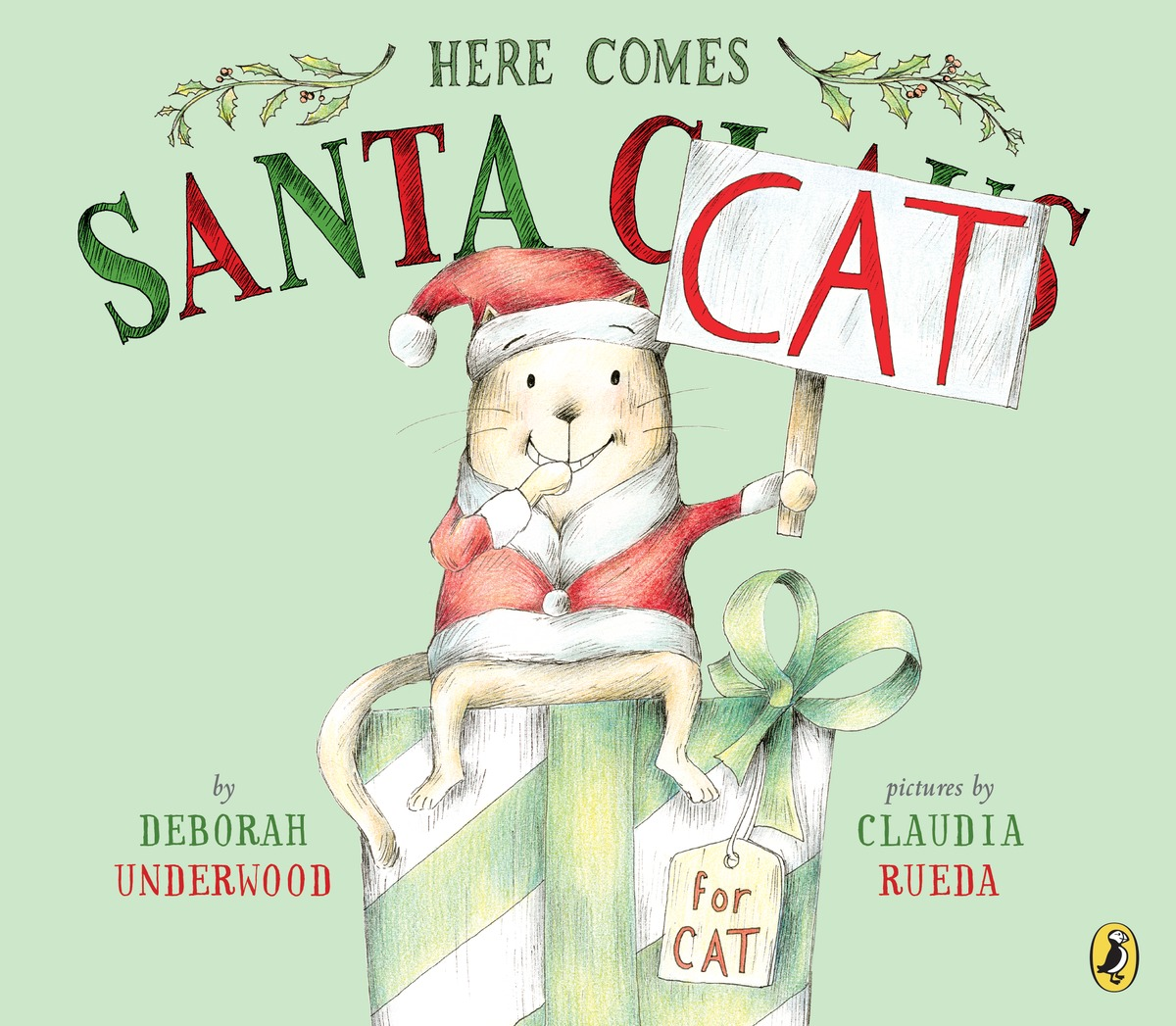 Here Comes Santa Cat a cat a hat and a piece of string