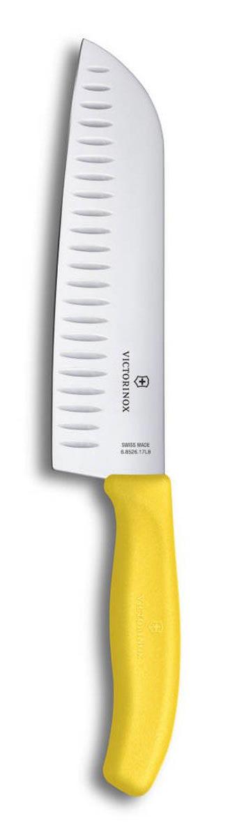 Нож сантоку Victorinox SwissClassic, цвет: желтый, длина лезвия 17 см6.8526.17L8BНож сантоку Victorinox SwissClassic - незаменимый помощник на вашей кухне. Лезвие, изготовленное из стали, более стойкое к воздействию кислот, содержащихся в продуктах, более гигиенично и не подвержено коррозии. Кроме того, лезвие из стали сохраняет остроту дольше, чем другие ножи. Легкая, отлично сбалансированная и приятная на ощупь рукоятка удобна в использовании. Такой нож идеально подходит для измельчения, нарезки ломтиками и кубиками овощей, фруктов, рыбы и мяса.