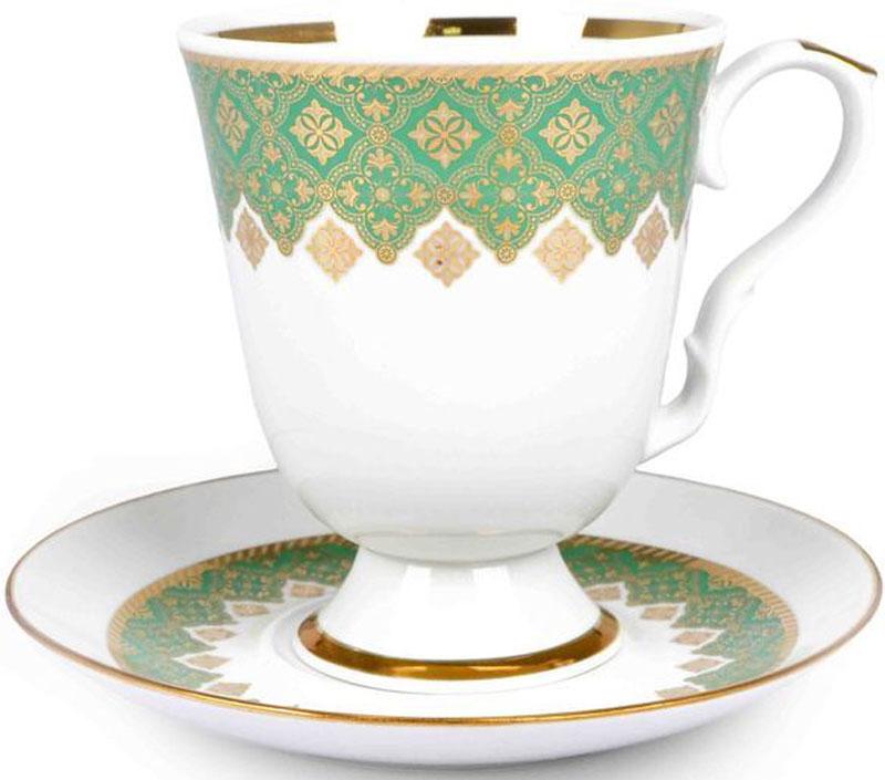"""Бокал Дулевский Фарфор """"Архитектурный"""" выполнен из высококачественного фарфора и оформлен оригинальным рисунком. Посуда из такого материала позволяет сохранить истинный вкус напитка, а также помогает ему дольше оставаться теплым. В комплект входит блюдце. Такой набор идеально подойдет для чая и придется по вкусу ценителям классики, и тем, кто предпочитает утонченность и изысканность."""