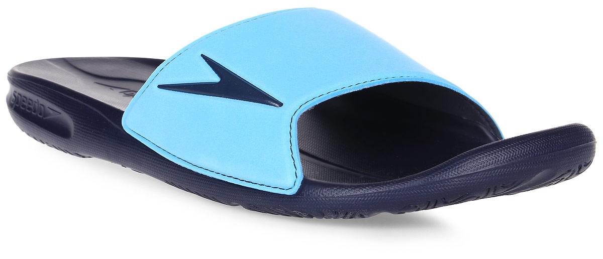 Шлепанцы мужские Speedo Atami II, цвет: темно-синий, голубой. 8-09072B553-B553. Размер 7 (40,5)8-09072B553-B553Мужские шлепанцы Atami II от Speedo очень удобны и невероятно легки. Верх оформлен логотипом бренда. Рифление на верхней поверхности подошвы, выполненной из ЭВА материала, предотвращает выскальзывание ноги, отверстия в области носка предназначены для слива воды. Специальный рисунок подошвы гарантирует оптимальное сцепление при ходьбе как по сухой, так и по влажной поверхности. Удобные шлепанцы прекрасно подойдут для похода в бассейн или на пляж.