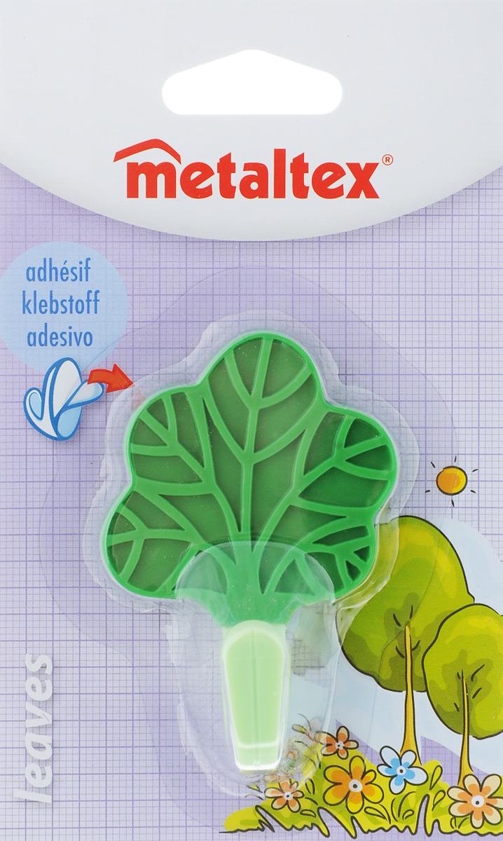 Крючок настенный Metaltex Leaves. Лист, цвет: зеленый, 5,5 х 8 х 4 см11107_зеленый/вид 2Настенный крючок Metaltex Leaves. Лист изготовлен из высококачественного цветного пластика в виде листа. Он прекрасно подойдет для вашей ванной комнаты или кухни и не займет много места, надежно выдержав все, что вы на него повесите. Крючок крепится на стену с помощью липкой ленты, которая находится на задней стороне крючка или при помощи шурупа (входит в комплект). Он приклеивается к гладкой, ровной и чистой поверхности. На него можно вешать полотенца или любые другие вещи.