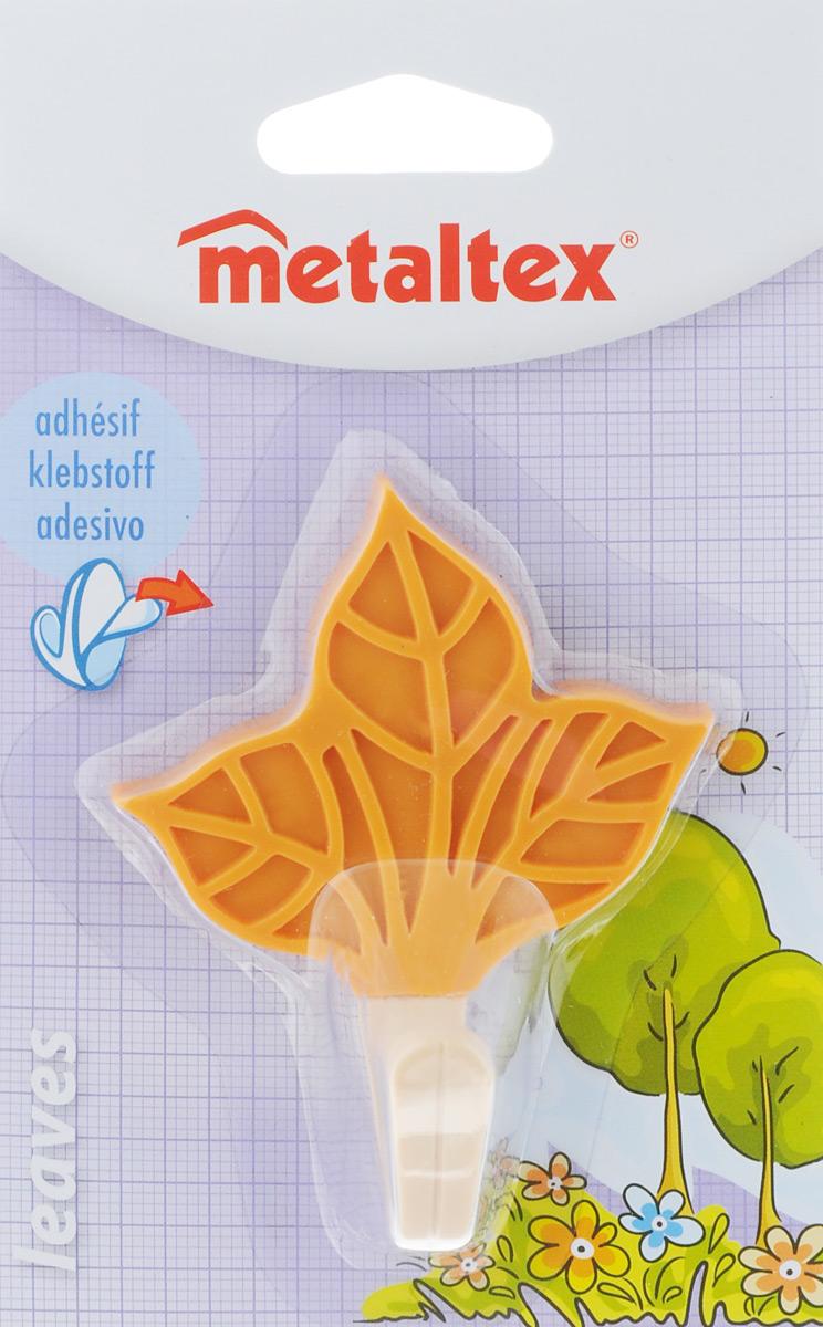 Крючок настенный Metaltex Leaves. Лист, 7 х 8,5 х 4 см11107_оранжевый/вид 2Настенный крючок Metaltex Leaves. Лист изготовлен из высококачественного цветного пластика в виде листа. Он прекрасно подойдет для вашей ванной комнаты или кухни и не займет много места, надежно выдержав все, что вы на него повесите. Крючок крепится на стену с помощью липкой ленты, которая находится на задней стороне крючка или при помощи шурупа (входит в комплект). Он приклеивается к гладкой, ровной и чистой поверхности. На него можно вешать полотенца или любые другие вещи.