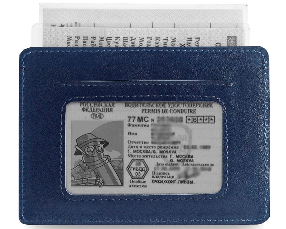 Обложка для автодокументов Zavtra, цвет: темно-синий. zav11bluzav11bluОбложка Zavtra, изготовленная из натуральной кожи, вмещает все автодокументы и необходимые пластиковые карты. Предусмотренное окошко позволяет не извлекать ВУ. Внутренняя подкладка основного кармана выполнена также из кожи. Минимализм - формфактор ограничен размерами ПТС.Обложка для водительского удостоверения Zavtra — выбор практичных и деловых людей. Документы, как и деньги, любят порядок, особенно водительские, которые всегда должны быть под рукой. Продуманный дизайн обложки Zavtra вмещает все необходимое, заставляя по-новому взглянуть на привычные вещи.Минимализм и удобное расположение отделов отличают обложку для водительского удостоверения Zavtra от аналогичных продуктов других производителей. Ультратонкий дизайн позволяет носить аксессуар в заднем кармане джинсов.