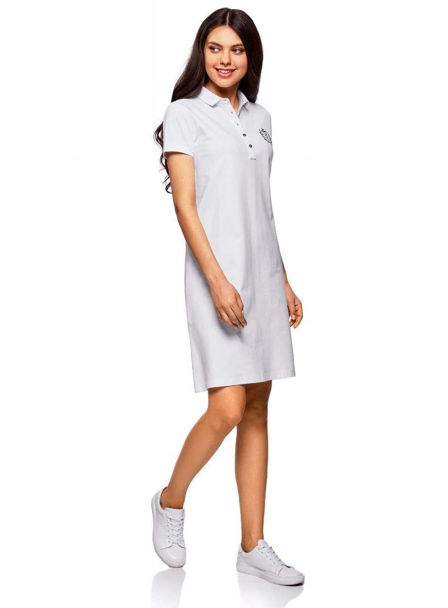 Платье oodji Collection, цвет: белый. 24001118-1/47005/1000N. Размер L (48)24001118-1/47005/1000NПлатье-поло от oodji выполнено из ткани пике. Модель с короткими рукавами и отложным воротником на груди застегивается на пуговицы.