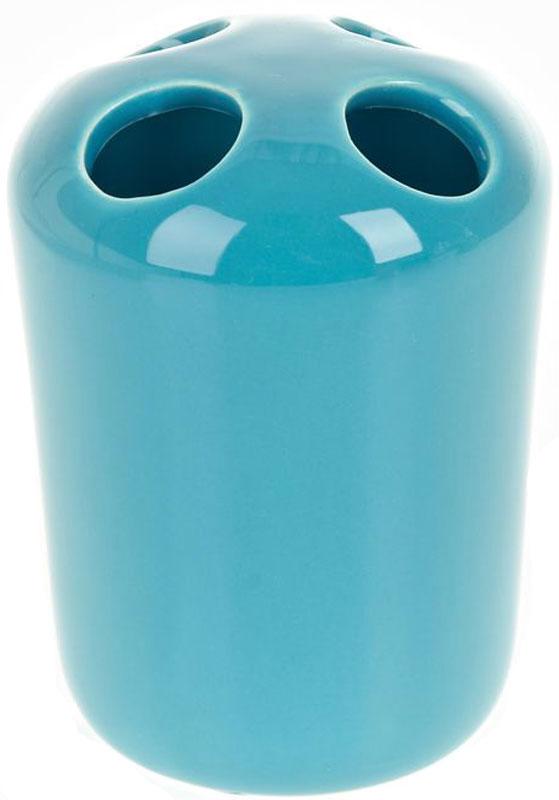 Стакан для зубных щеток White Clean Blue, 250 мл8290024Стакан для зубных щеток White Clean Blue изготовлен из прочной качественной керамики голубого цвета, покрытой глянцевой глазурью. Оснащен отверстиями для зубных щеток. Такой стакан красиво дополнит интерьер ванной комнаты и отлично сочетается с другими аксессуарами из коллекции Blue.