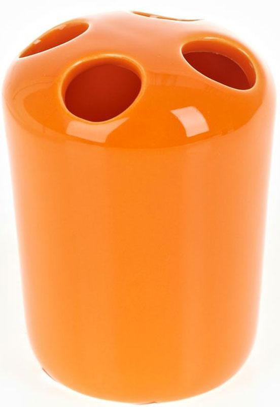 Стакан для зубных щеток White Clean Orange, 250 мл8290036Стакан для зубных щеток White Clean Orange изготовлен из прочной качественной керамики, покрытой глянцевой глазурью. Оснащен отверстиями для зубных щеток. Такой стакан красиво дополнит интерьер ванной комнаты и создаст особую атмосферу уюта и комфорта. Объем: 250 мл.