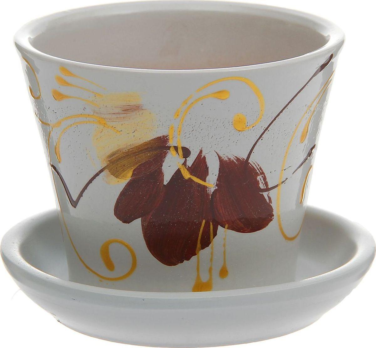 Кашпо Орхидея, 0,3 л1177409Комнатные растения — всеобщие любимцы. Они радуют глаз, насыщают помещение кислородом и украшают пространство. Каждому из них необходим свой удобный и красивый дом. Кашпо из керамики прекрасно подходят для высадки растений: за счет пластичности глины и разных способов обработки существует великое множество форм и дизайнов пористый материал позволяет испаряться лишней влаге воздух, необходимый для дыхания корней, проникает сквозь керамические стенки! позаботится о зеленом питомце, освежит интерьер и подчеркнет его стиль.