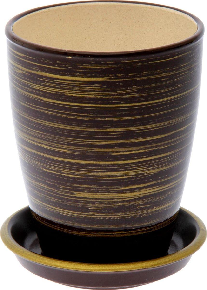 Кашпо Керамика ручной работы Орхидейница, цвет: шоколадный, золотой, 1,3 л1489723Комнатные растения — всеобщие любимцы. Они радуют глаз, насыщают помещение кислородом и украшают пространство. Каждому из них необходим свой удобный и красивый дом. Кашпо из керамики прекрасно подходят для высадки растений: за счёт пластичности глины и разных способов обработки существует великое множество форм и дизайновпористый материал позволяет испаряться лишней влагевоздух, необходимый для дыхания корней, проникает сквозь керамические стенки! #name# позаботится о зелёном питомце, освежит интерьер и подчеркнёт его стиль.