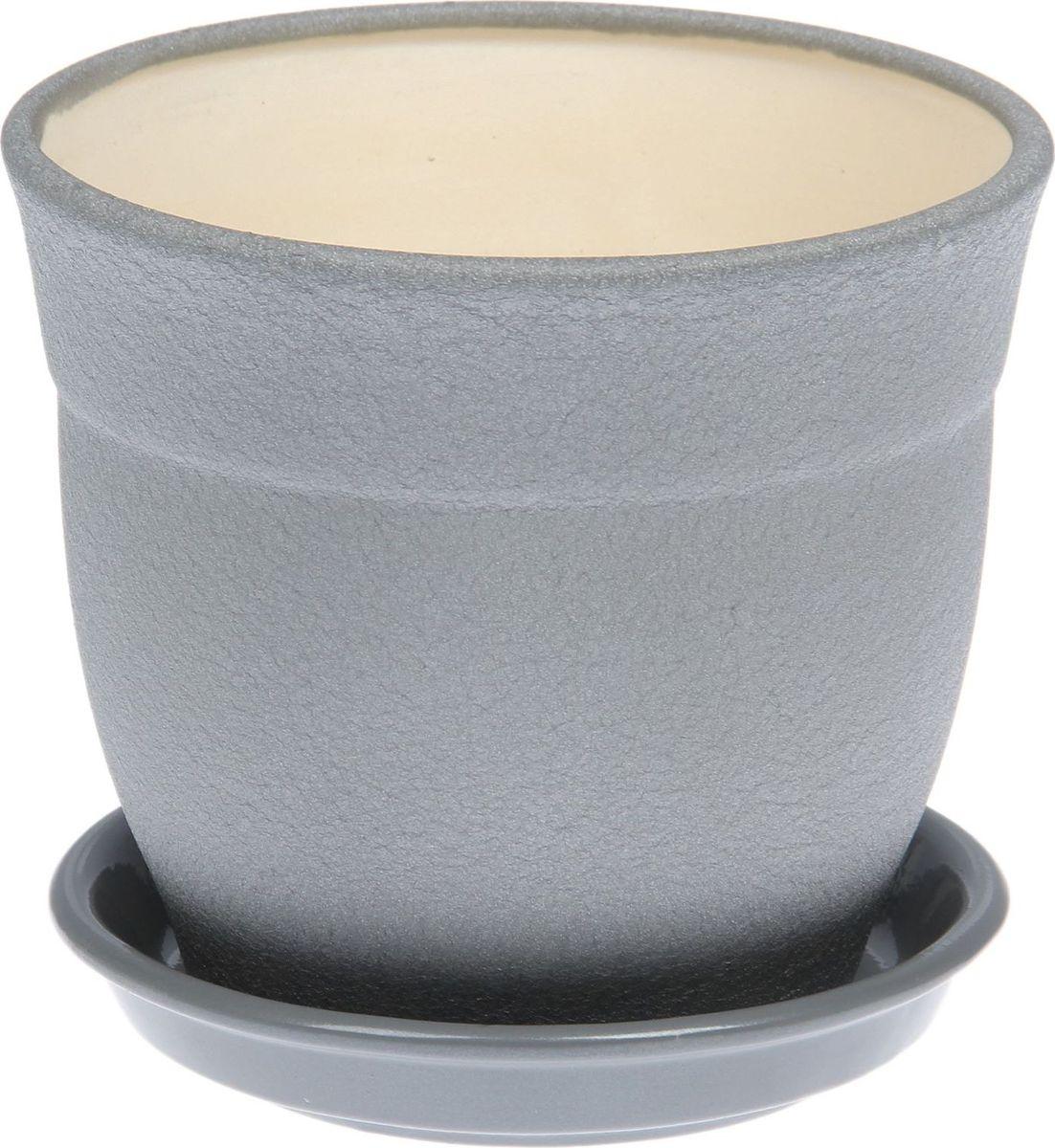 Кашпо Керамика ручной работы Флорис, цвет: серебристый, 1,2 л1489728Комнатные растения — всеобщие любимцы. Они радуют глаз, насыщают помещение кислородом и украшают пространство. Каждому из них необходим свой удобный и красивый дом. Кашпо из керамики прекрасно подходят для высадки растений: за счет пластичности глины и разных способов обработки существует великое множество форм и дизайнов пористый материал позволяет испаряться лишней влаге воздух, необходимый для дыхания корней, проникает сквозь керамические стенки! позаботится о зеленом питомце, освежит интерьер и подчеркнет его стиль.