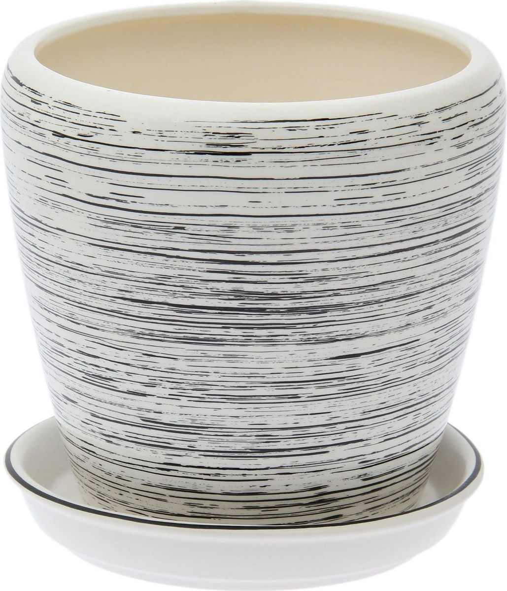 Кашпо Керамика ручной работы Грация. Глянец, цвет: черный, белый, 1,2 л1489664Комнатные растения — всеобщие любимцы. Они радуют глаз, насыщают помещение кислородом и украшают пространство. Каждому из них необходим свой удобный и красивый дом. Кашпо из керамики прекрасно подходят для высадки растений: за счёт пластичности глины и разных способов обработки существует великое множество форм и дизайновпористый материал позволяет испаряться лишней влагевоздух, необходимый для дыхания корней, проникает сквозь керамические стенки! #name# позаботится о зелёном питомце, освежит интерьер и подчеркнёт его стиль.