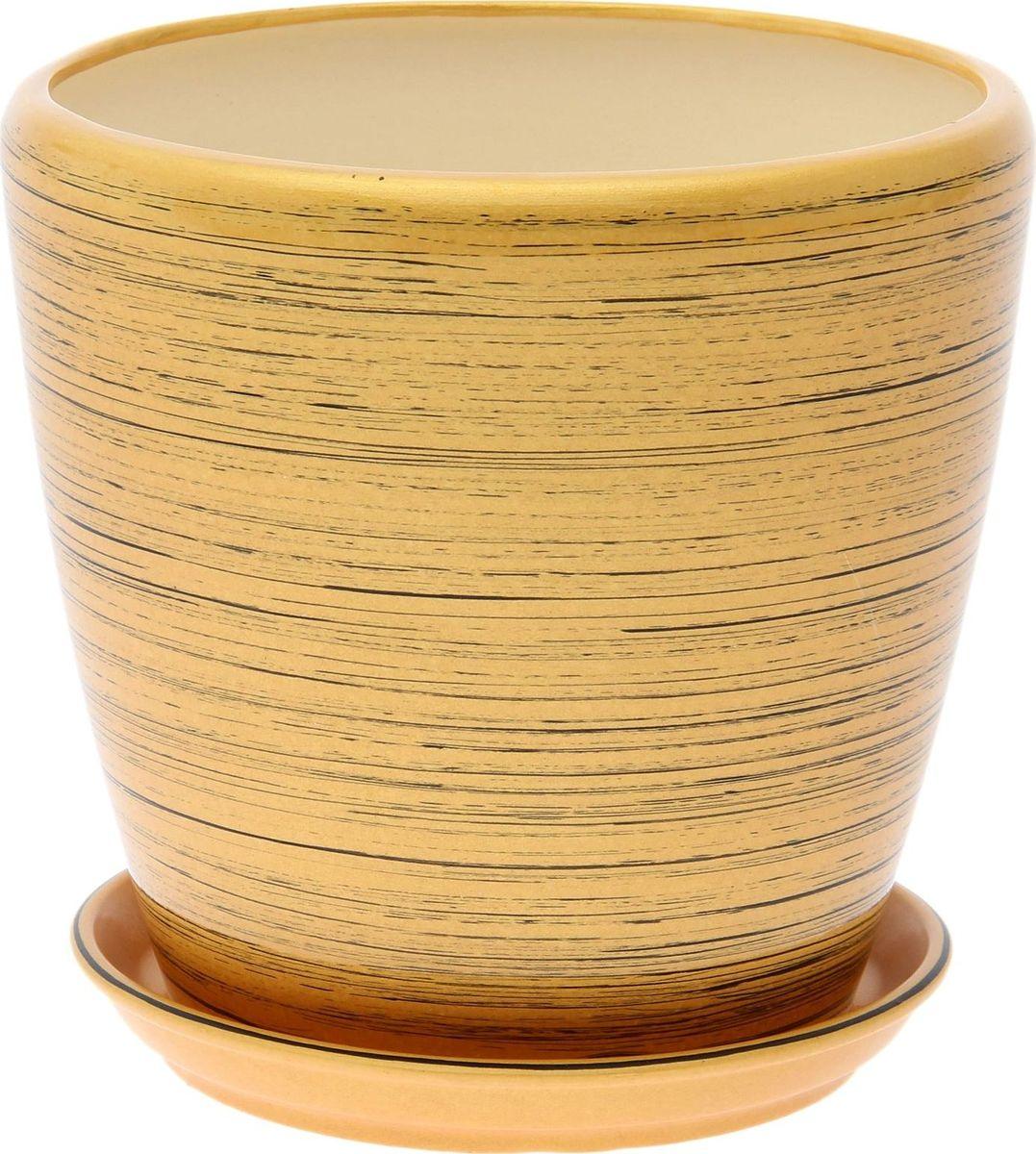Кашпо Керамика ручной работы Грация. Глянец, цвет: золотой, черный, 2,3 л1489678Комнатные растения — всеобщие любимцы. Они радуют глаз, насыщают помещение кислородом и украшают пространство. Каждому из них необходим свой удобный и красивый дом. Кашпо из керамики прекрасно подходят для высадки растений: за счёт пластичности глины и разных способов обработки существует великое множество форм и дизайновпористый материал позволяет испаряться лишней влагевоздух, необходимый для дыхания корней, проникает сквозь керамические стенки! #name# позаботится о зелёном питомце, освежит интерьер и подчеркнёт его стиль.