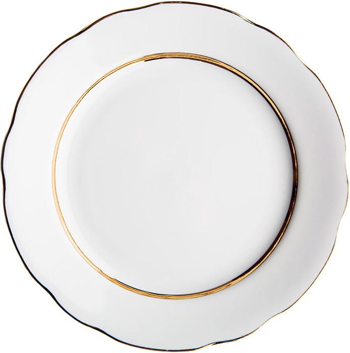 """Тарелка Дулевский Фарфор """"Монреаль"""" выполнена из высококачественного фарфора, покрытого глазурью. Изделие дополнено золотым ободком и вырезным краем. Такая тарелка отлично подойдет для подачи десертов, а также нарезок или закусок."""