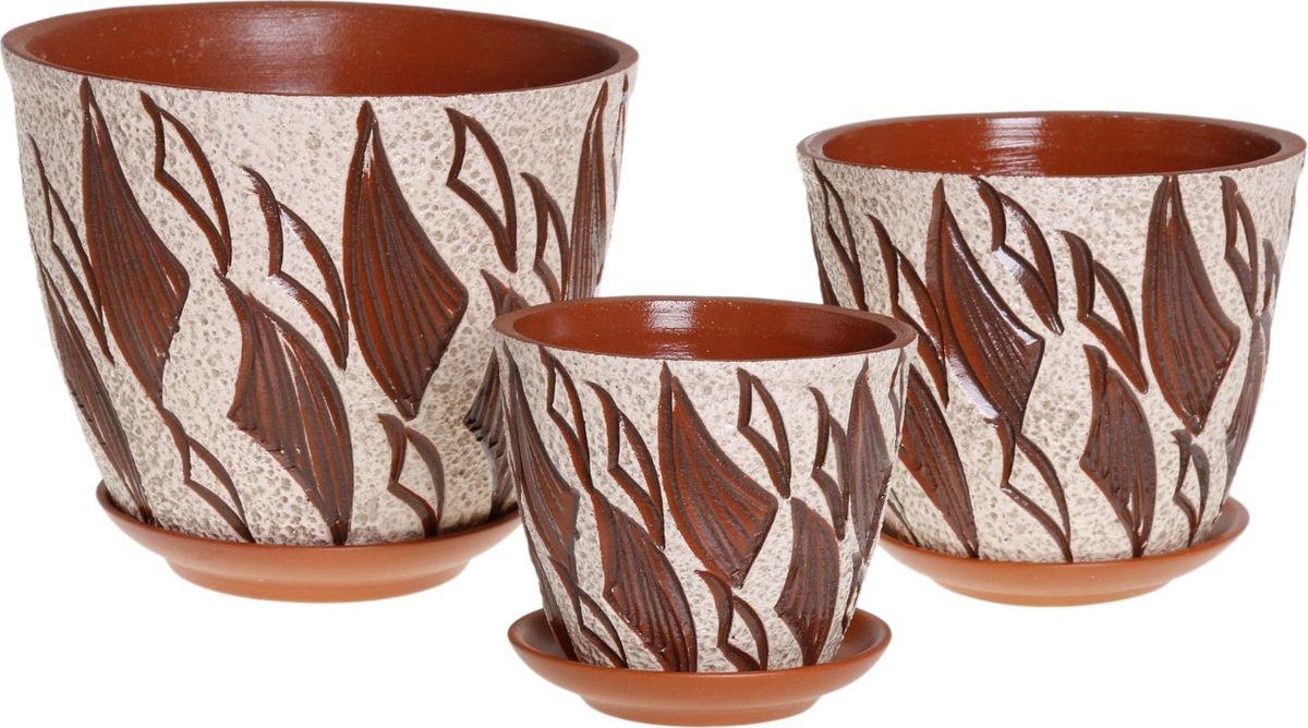 Набор кашпо Премьера. Пламя, 3 предмета1039852Комнатные растения — всеобщие любимцы. Они радуют глаз, насыщают помещение кислородом и украшают пространство. Каждому из них необходим свой удобный и красивый дом. Кашпо из керамики прекрасно подходят для высадки растений: за счёт пластичности глины и разных способов обработки существует великое множество форм и дизайновпористый материал позволяет испаряться лишней влагевоздух, необходимый для дыхания корней, проникает сквозь керамические стенки! #name# позаботится о зелёном питомце, освежит интерьер и подчеркнёт его стиль.