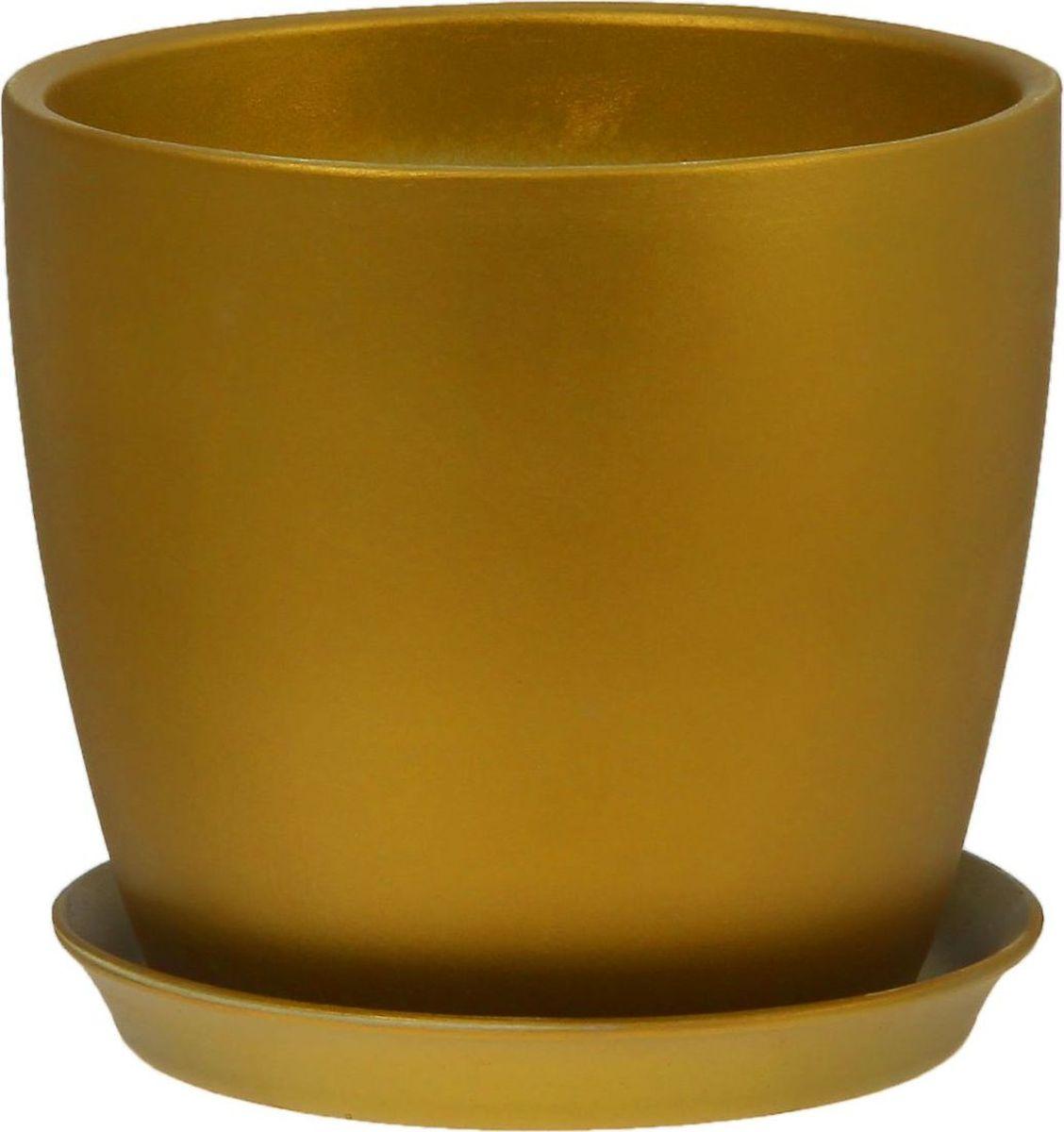 Кашпо Керамика ручной работы Осень, цвет: темно-зеленый, 2 л1062706Комнатные растения - всеобщие любимцы. Они радуют глаз, насыщают помещение кислородом и украшают пространство. Каждому из них необходим свой удобный и красивый дом. Кашпо из керамики прекрасно подходят для высадки растений:пористый материал позволяет испаряться лишней влаге;воздух, необходимый для дыхания корней, проникает сквозь керамические стенки. Кашпо Осень позаботится о зеленом питомце, освежит интерьер и подчеркнет его стиль.