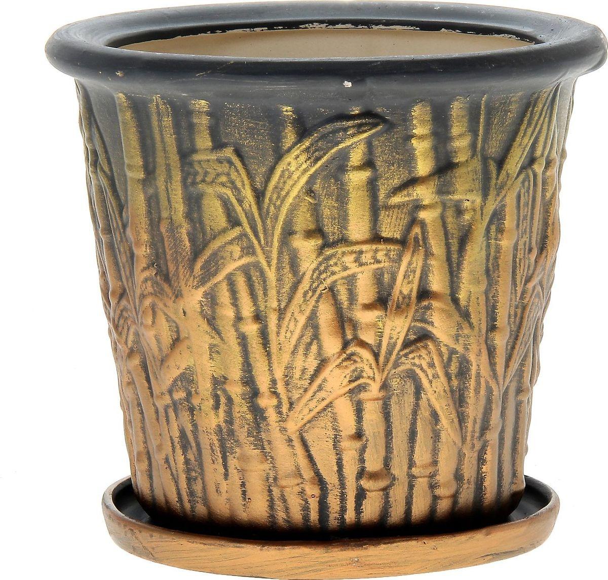 Кашпо Керамика ручной работы Камыш, цвет: черный, золотистый, 5 л144198Комнатные растения — всеобщие любимцы. Они радуют глаз, насыщают помещение кислородом и украшают пространство. Каждому из них необходим свой удобный и красивый дом. Кашпо из керамики прекрасно подходят для высадки растений: за счёт пластичности глины и разных способов обработки существует великое множество форм и дизайновпористый материал позволяет испаряться лишней влагевоздух, необходимый для дыхания корней, проникает сквозь керамические стенки! #name# позаботится о зелёном питомце, освежит интерьер и подчеркнёт его стиль.