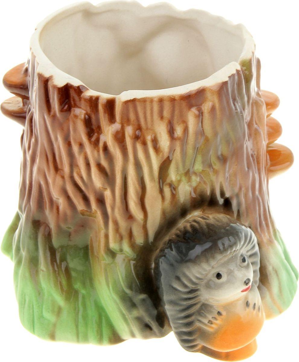 Кашпо Керамика ручной работы Пень с ежиком, 1,5 л835424Комнатные растения — всеобщие любимцы. Они радуют глаз, насыщают помещение кислородом и украшают пространство. Каждому из растений необходим свой удобный и красивый дом. Поселите зелёного питомца в яркое и оригинальное фигурное кашпо. Выберите подходящую форму для детской, спальни, гостиной, балкона, офиса или террасы. #name# позаботится о растении, украсит окружающее пространство и подчеркнёт его оригинальный стиль.