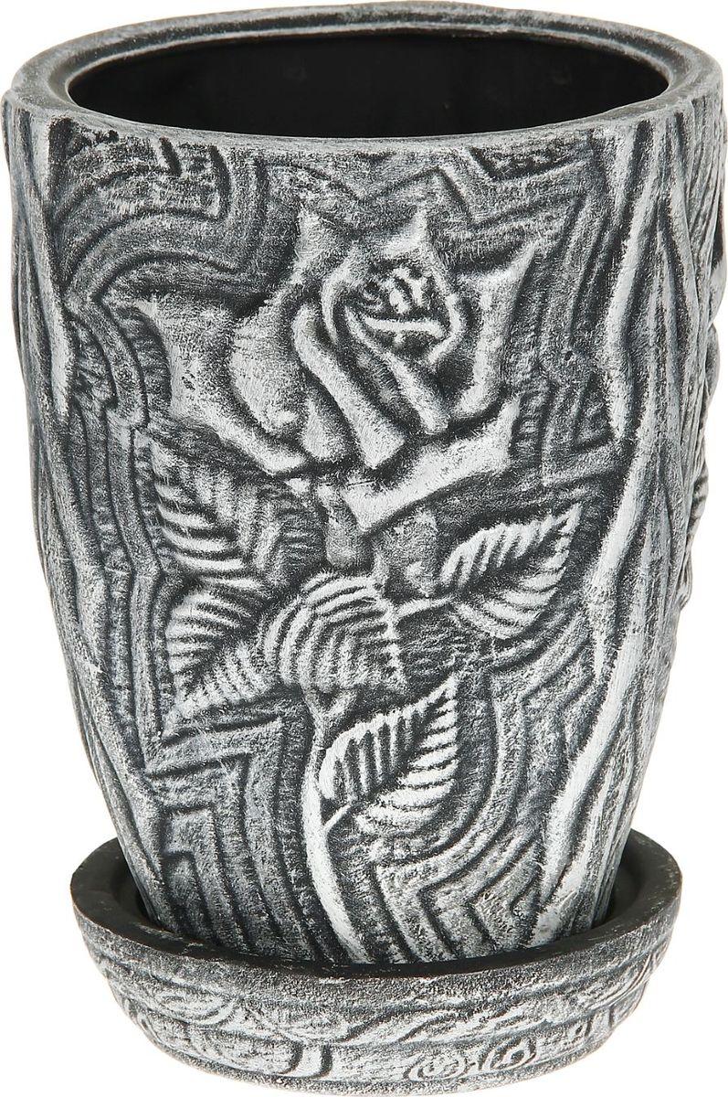 Кашпо Керамика ручной работы Роза, цвет: черный, белый, 5 л1114304Комнатные растения - всеобщие любимцы. Они радуют глаз, насыщают помещение кислородом и украшают пространство. Каждому из них необходим свой удобный и красивый дом. Кашпо из керамики прекрасно подходят для высадки растений: за счет пластичности глины и разных способов обработки существует великое множество форм и дизайнов. Пористый материал позволяет испаряться лишней влаге. Воздух, необходимый для дыхания корней, проникает сквозь керамические стенки.