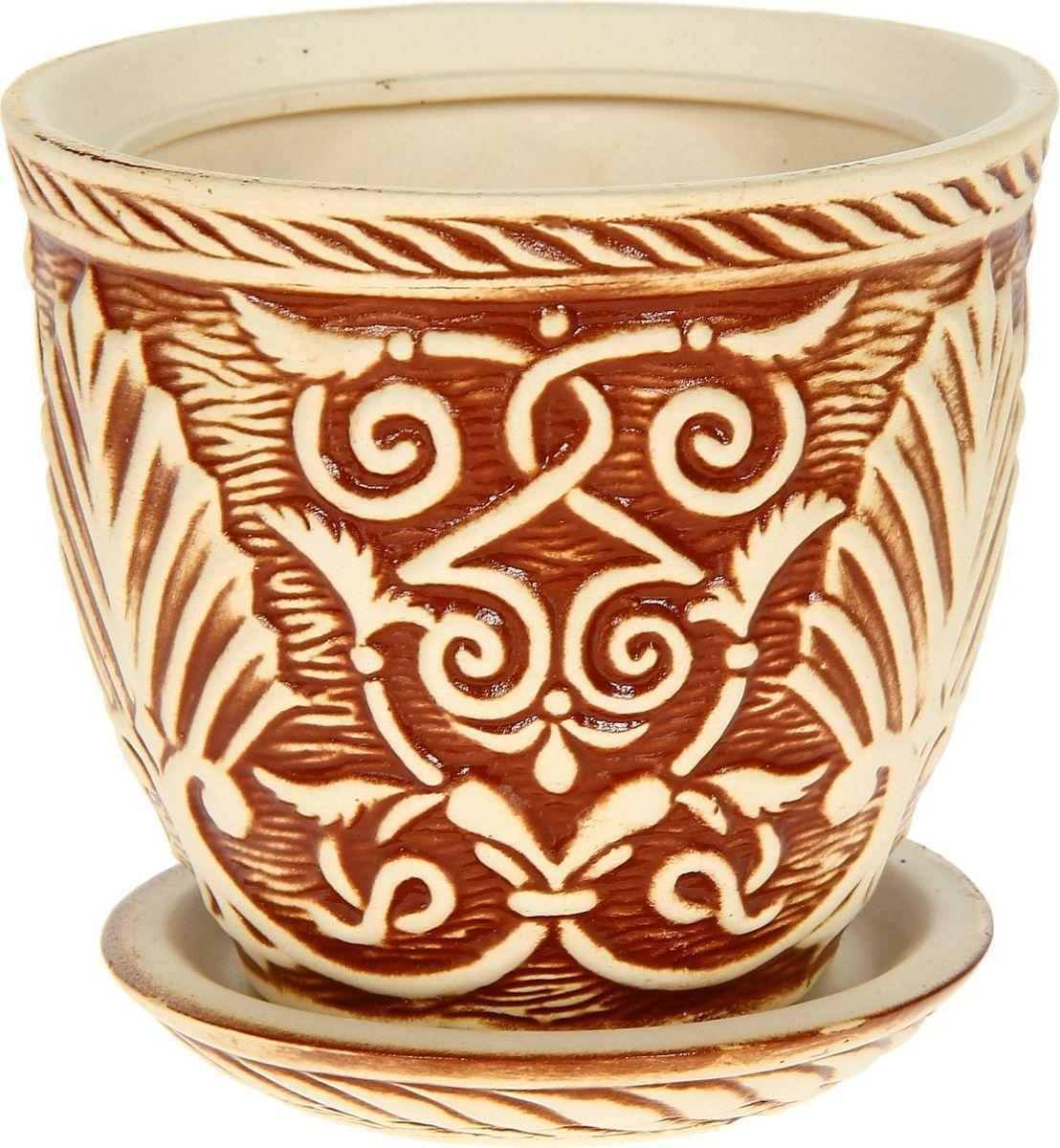 Кашпо Керамика ручной работы Славянское. Глазурь, цвет: коричневый, 1,2 л1114318Комнатные растения — всеобщие любимцы. Они радуют глаз, насыщают помещение кислородом и украшают пространство. Каждому из них необходим свой удобный и красивый дом. Кашпо из керамики прекрасно подходят для высадки растений: за счёт пластичности глины и разных способов обработки существует великое множество форм и дизайновпористый материал позволяет испаряться лишней влагевоздух, необходимый для дыхания корней, проникает сквозь керамические стенки! #name# позаботится о зелёном питомце, освежит интерьер и подчеркнёт его стиль.