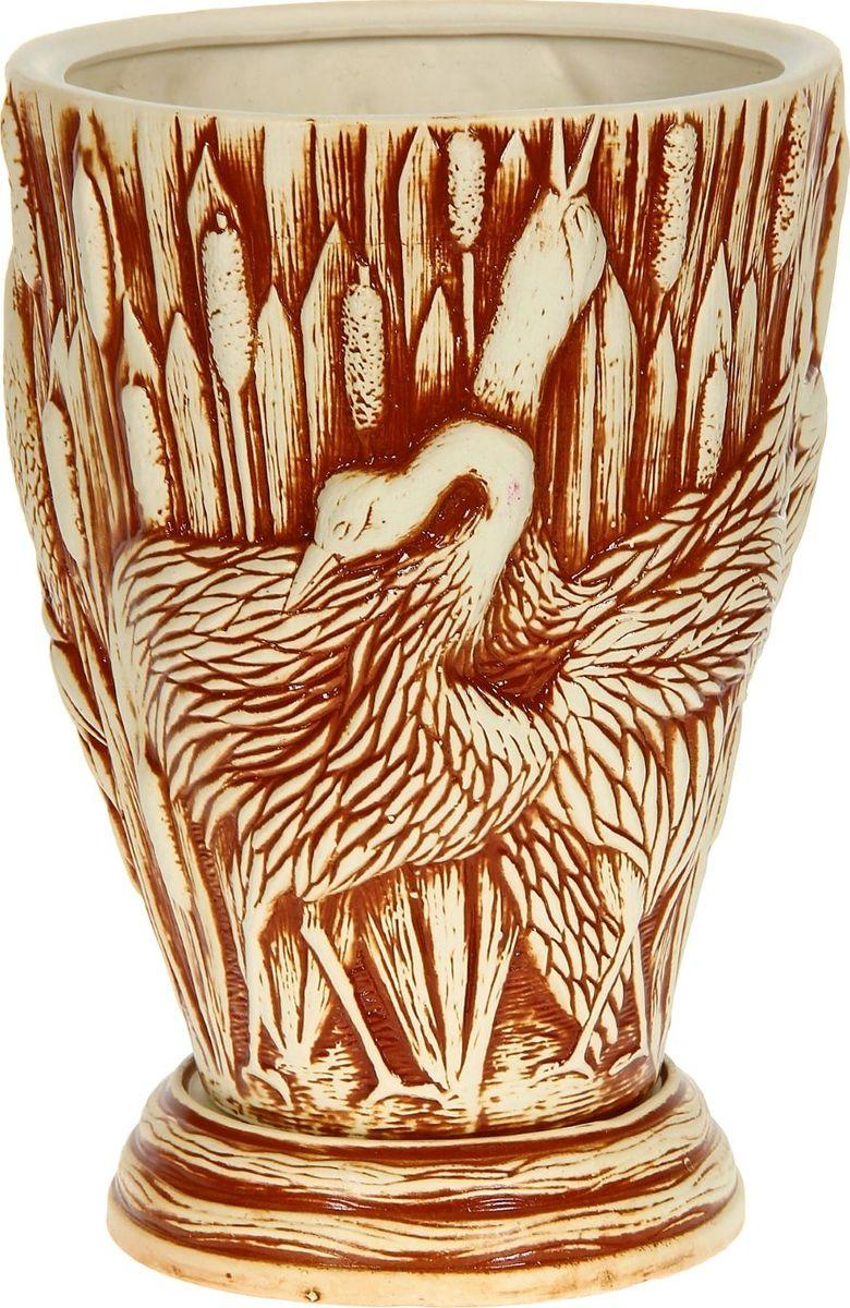 Кашпо Керамика ручной работы Танец журавлей, цвет: коричневый, 19 л1114328Комнатные растения — всеобщие любимцы. Они радуют глаз, насыщают помещение кислородом и украшают пространство. Каждому из них необходим свой удобный и красивый дом. Кашпо из керамики прекрасно подходят для высадки растений: за счёт пластичности глины и разных способов обработки существует великое множество форм и дизайновпористый материал позволяет испаряться лишней влагевоздух, необходимый для дыхания корней, проникает сквозь керамические стенки! #name# позаботится о зелёном питомце, освежит интерьер и подчеркнёт его стиль.