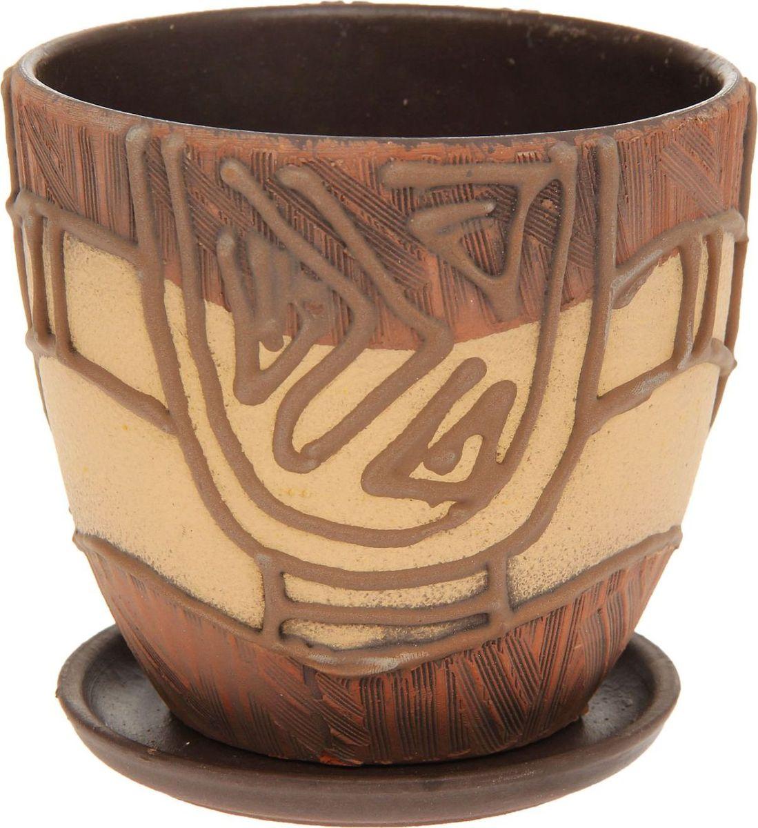 Кашпо Водоворот, 0,8 л1138556Декоративное кашпо, выполненное из высококачественной керамики, предназначено для посадки декоративных растений и станет прекрасным украшением для дома. Благодаря своему дизайну впишется в любой интерьер помещения.
