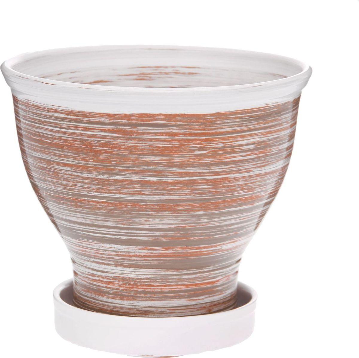 Кашпо Мари, цвет: коричневый, 2 л1147357Комнатные растения — всеобщие любимцы. Они радуют глаз, насыщают помещение кислородом и украшают пространство. Каждому из них необходим свой удобный и красивый дом. Кашпо из керамики прекрасно подходят для высадки растений: за счёт пластичности глины и разных способов обработки существует великое множество форм и дизайновпористый материал позволяет испаряться лишней влагевоздух, необходимый для дыхания корней, проникает сквозь керамические стенки! #name# позаботится о зелёном питомце, освежит интерьер и подчеркнёт его стиль.