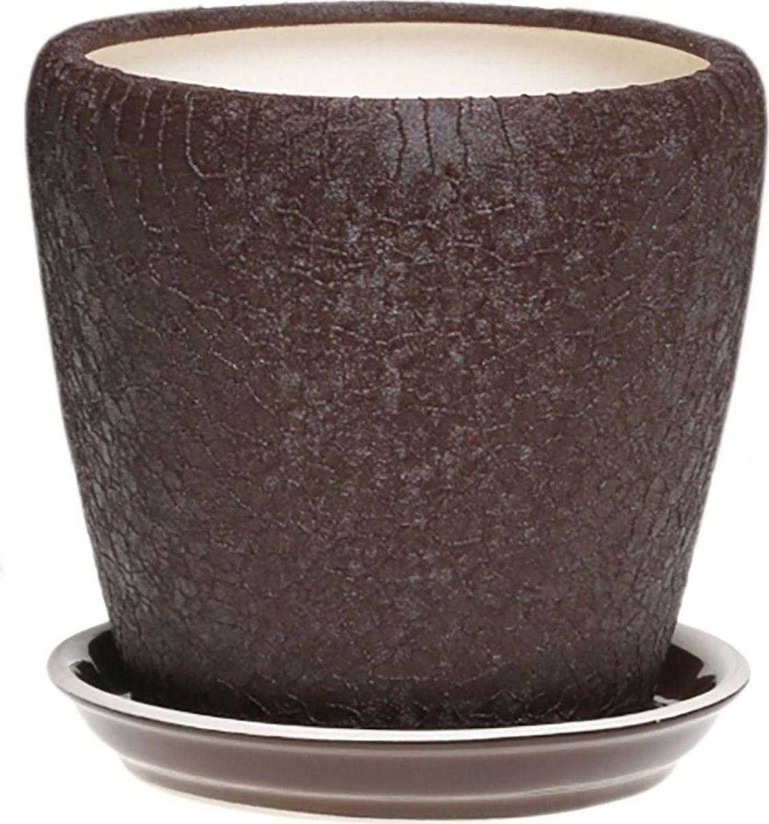 Кашпо Керамика ручной работы Грация, цвет: шоколадный, 1,2 л1158475Комнатные растения — всеобщие любимцы. Они радуют глаз, насыщают помещение кислородом и украшают пространство. Каждому из них необходим свой удобный и красивый дом. Кашпо из керамики прекрасно подходят для высадки растений: за счет пластичности глины и разных способов обработки существует великое множество форм и дизайнов пористый материал позволяет испаряться лишней влаге воздух, необходимый для дыхания корней, проникает сквозь керамические стенки! позаботится о зеленом питомце, освежит интерьер и подчеркнет его стиль.